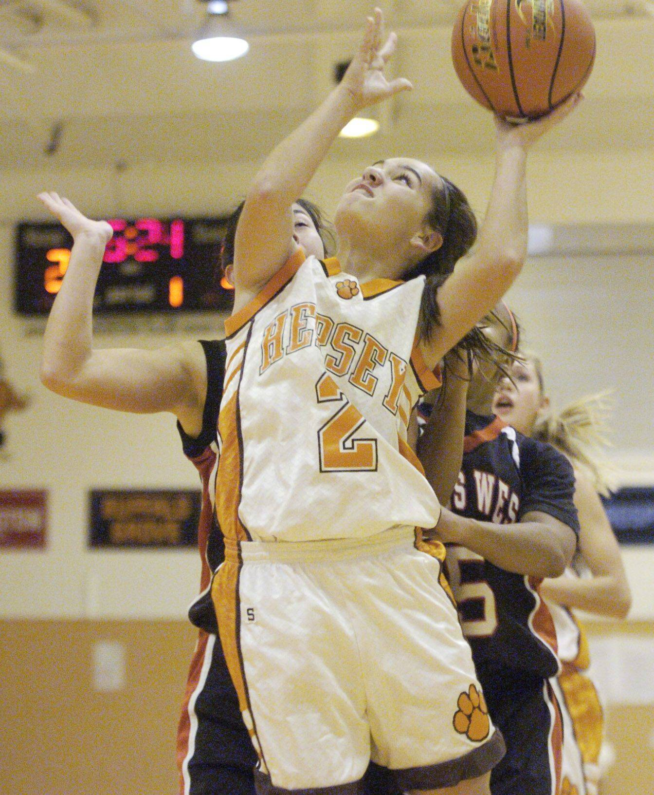 Hersey's Jen Hall shoots against Niles West.