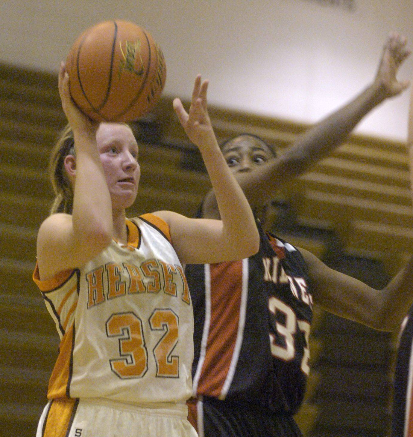 Hersey's Megan Rogowski shoots whole being guarded by Niles West's Jewell Lloyd.