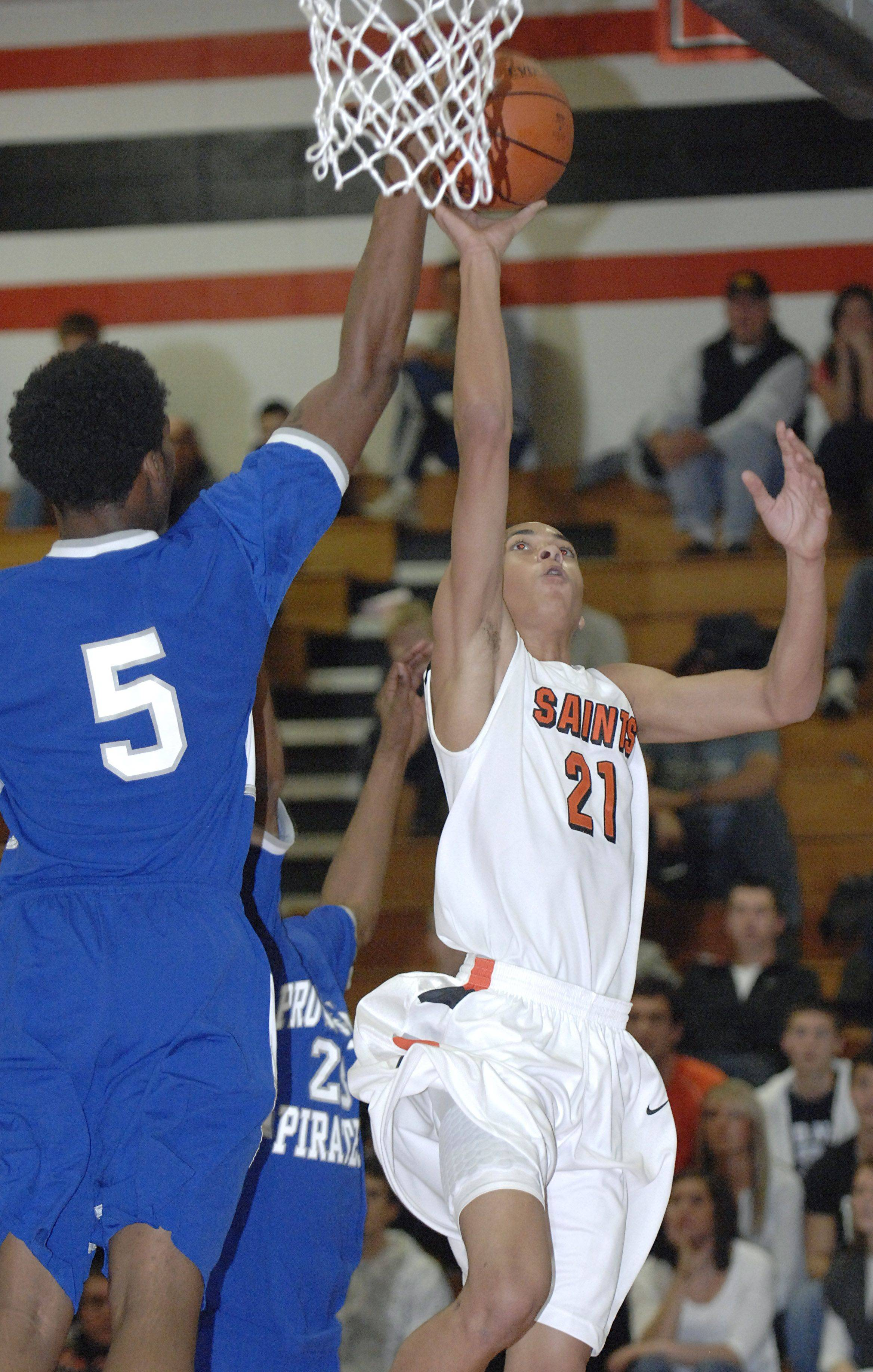 St. Charles East's Kendall Stephens sinks a shot past Proviso East's Trashaun Carroll in the first quarter of tournament game on Tuesday, November 22.