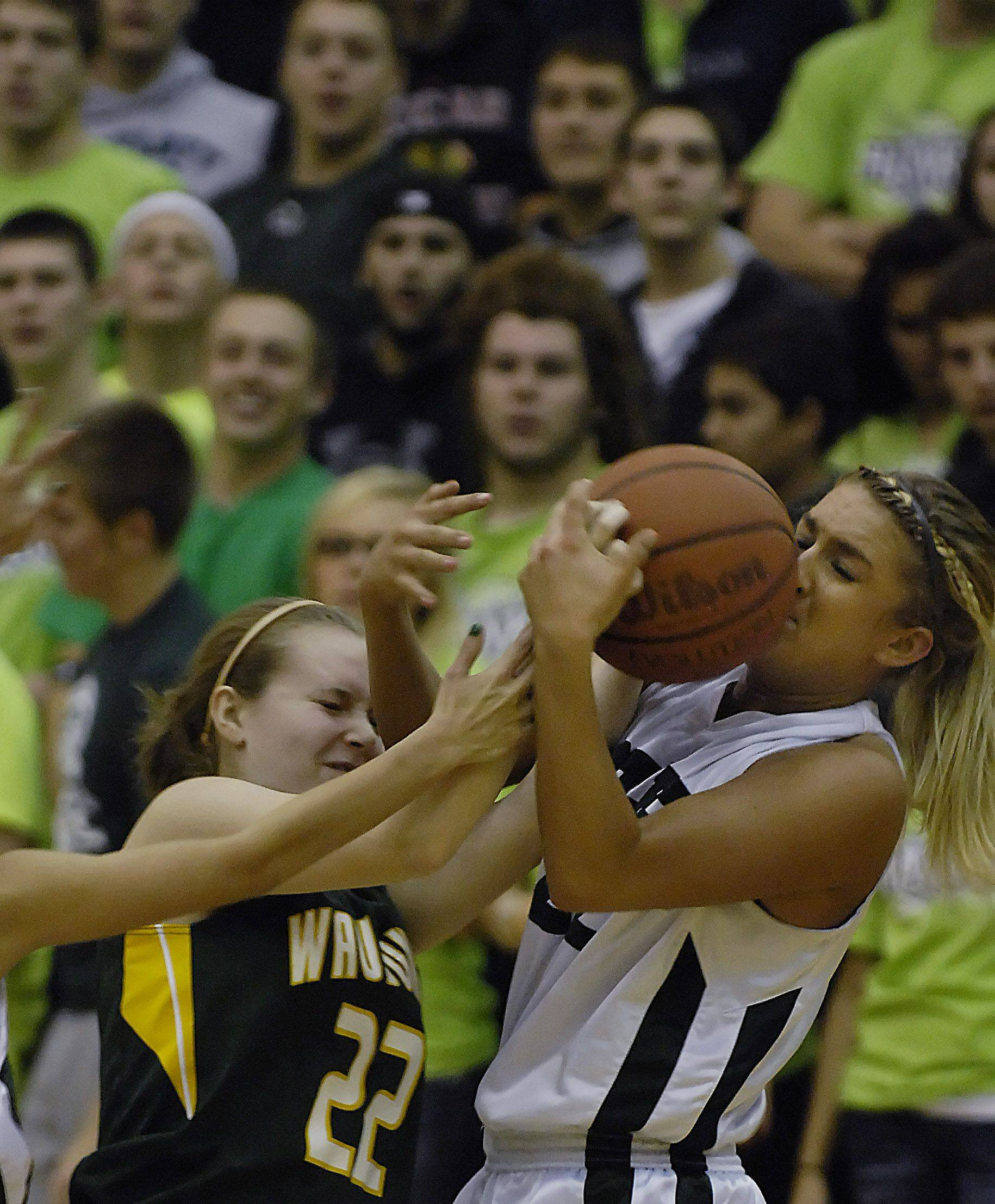 Bartlett's Haley Videckis takes the ball from Waubonsie Valley's Rachel Benn.