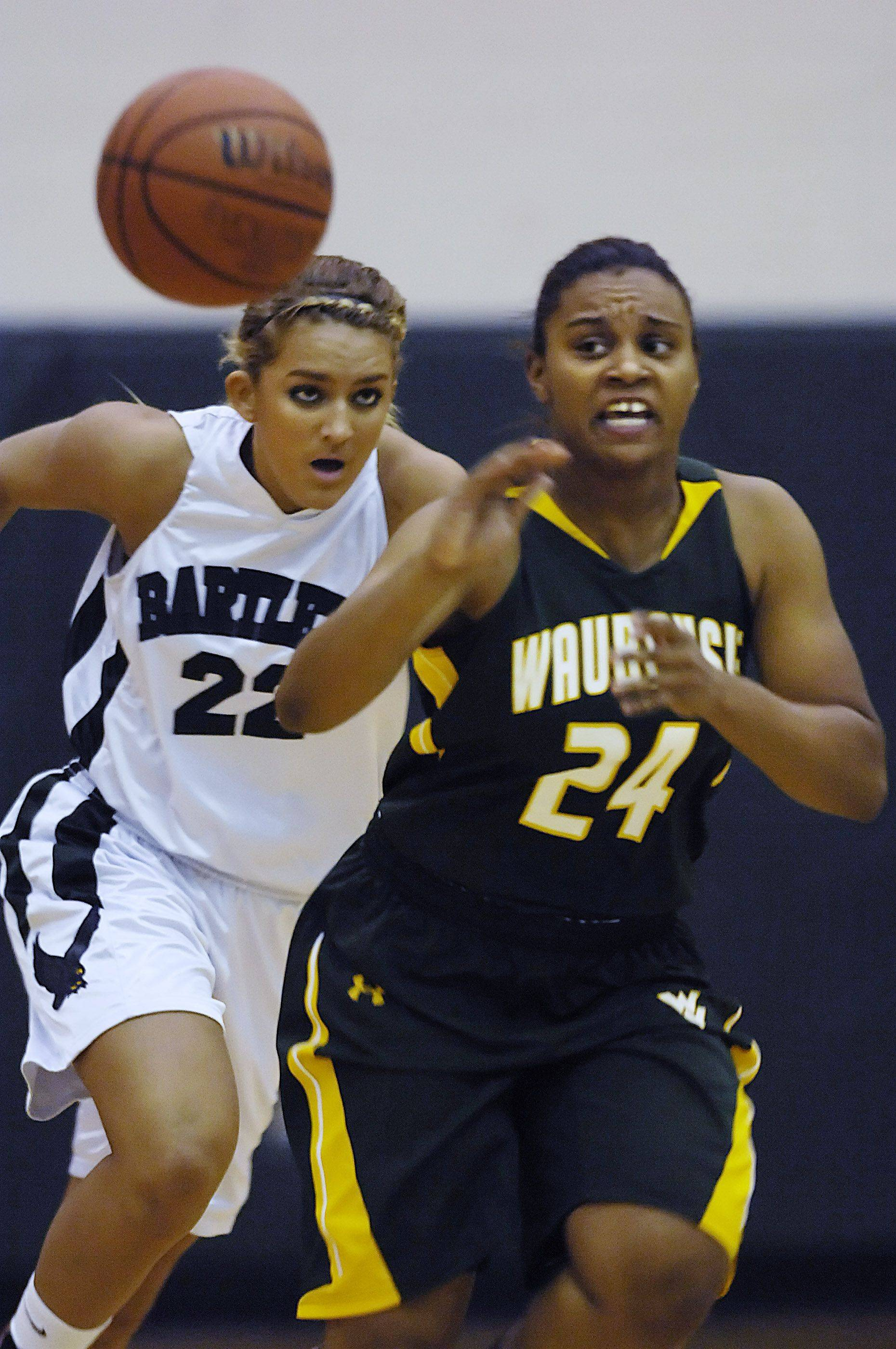 Waubonsie Valley's Tanysha Gardner-Walls passes the ball as Bartlett's Haley Videckis chases upcourt.