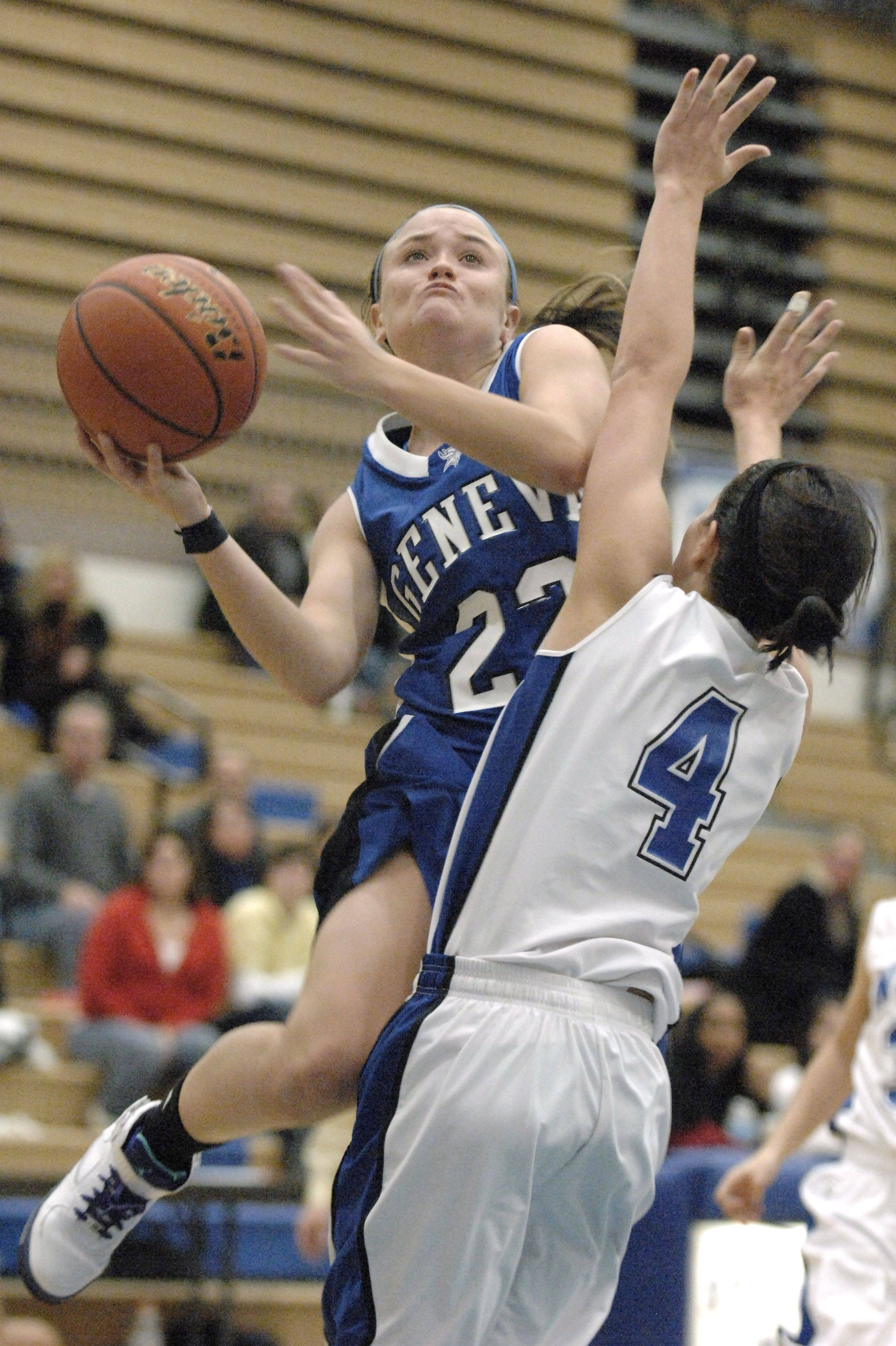 Geneva guard Sammy Scofield goes up for the shot over St. Charles North's Sydney Russell.
