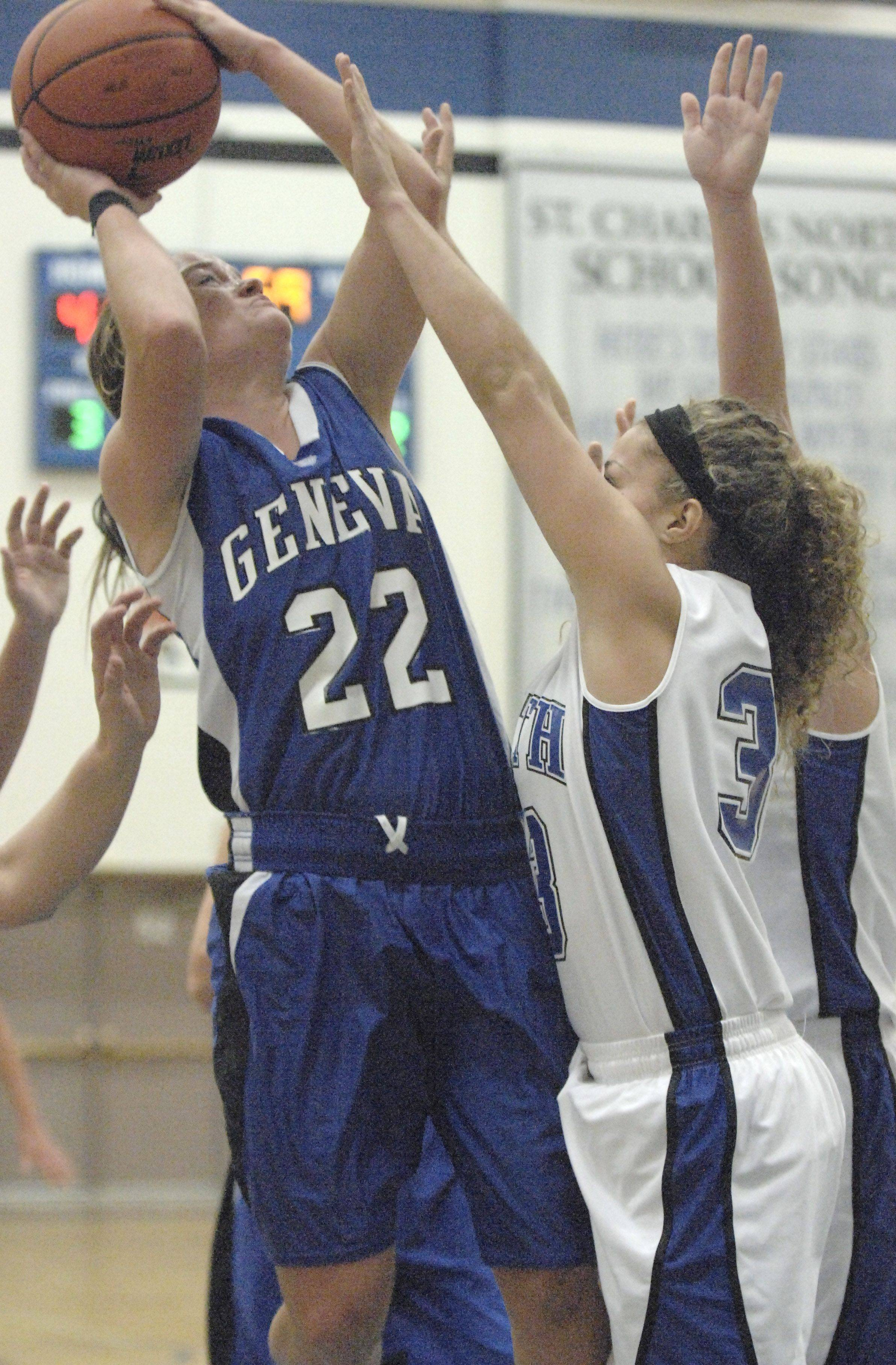 Geneva Sammy Scofield attempts a shot in the third quarter with St. Charles North's Taylor Russell blocking.