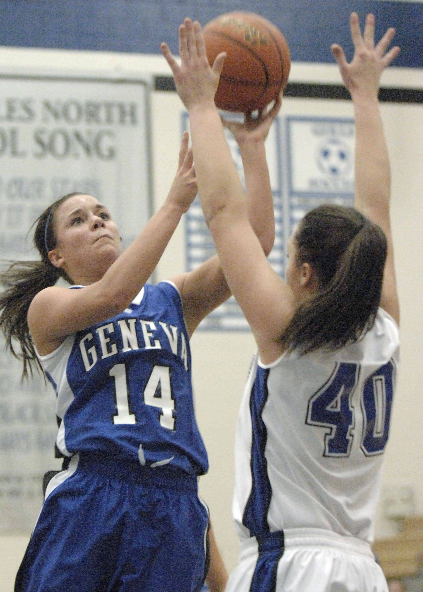 Geneva's Kat Yelle reaches over St. Charles North's Tess Fischer for a shot in the third quarter.