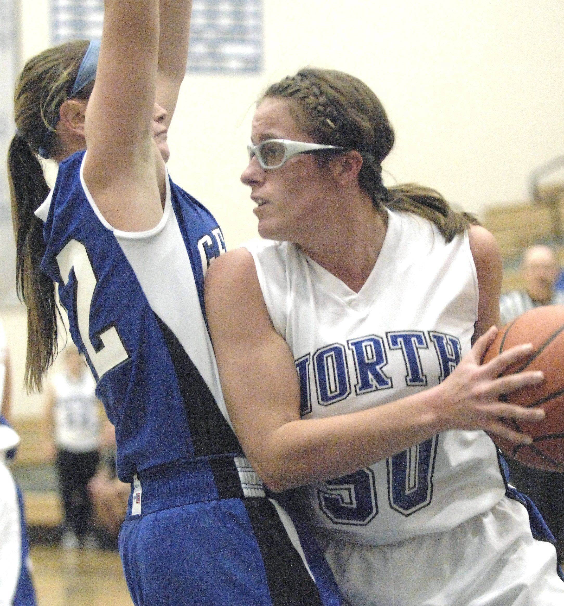 St. Charles North's Kate Booe makes her way around Geneva's Sammy Scofield.
