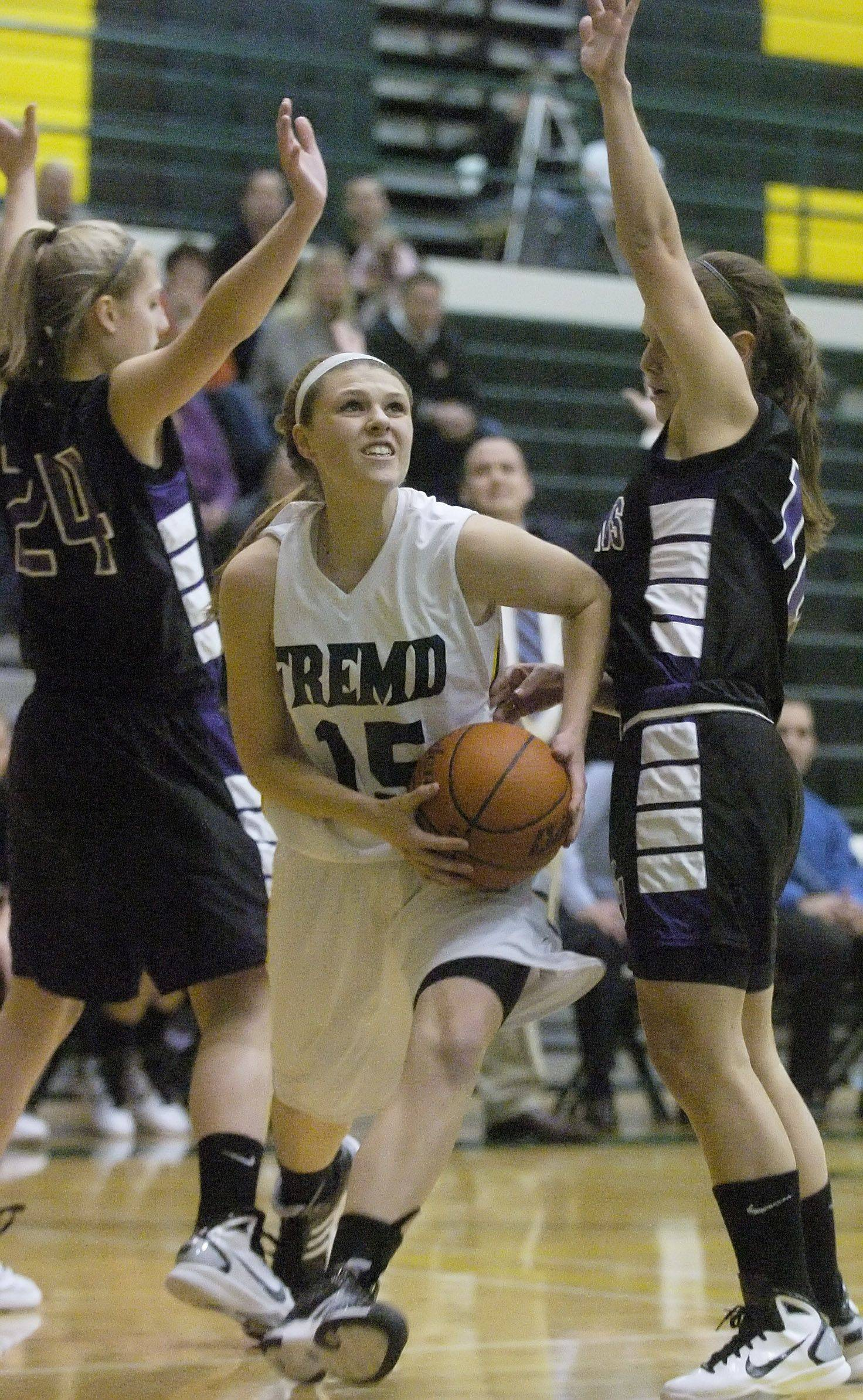 Jaimie Groot of Fremd, middle, steps between Alexis Glasgow, left, and Madelynn Conlin of Rolling Meadows.