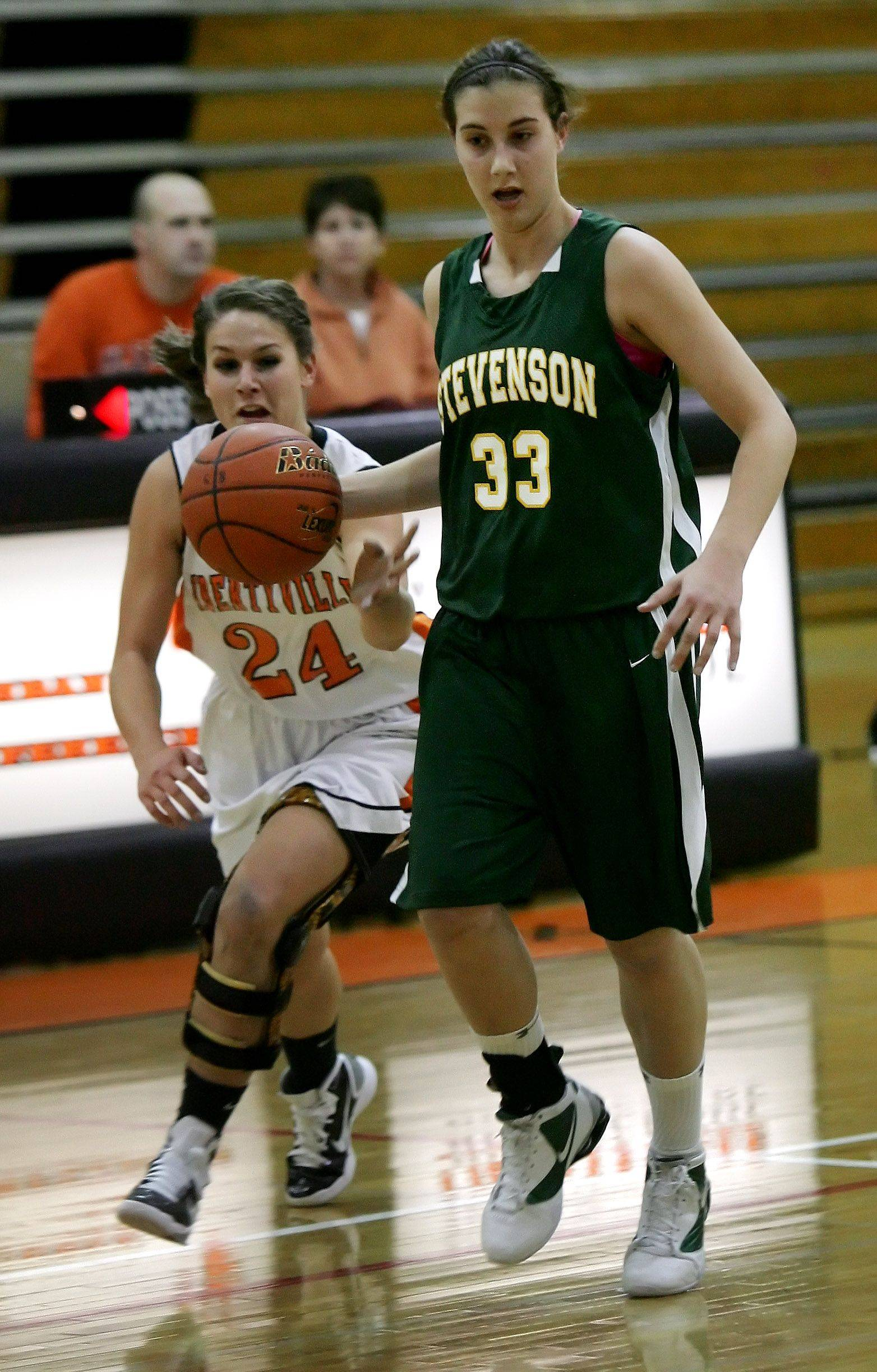 Libertyville forward Kaca Savatic comes from behind to steal the ball from Stevenson forward Michelle O'Brien.