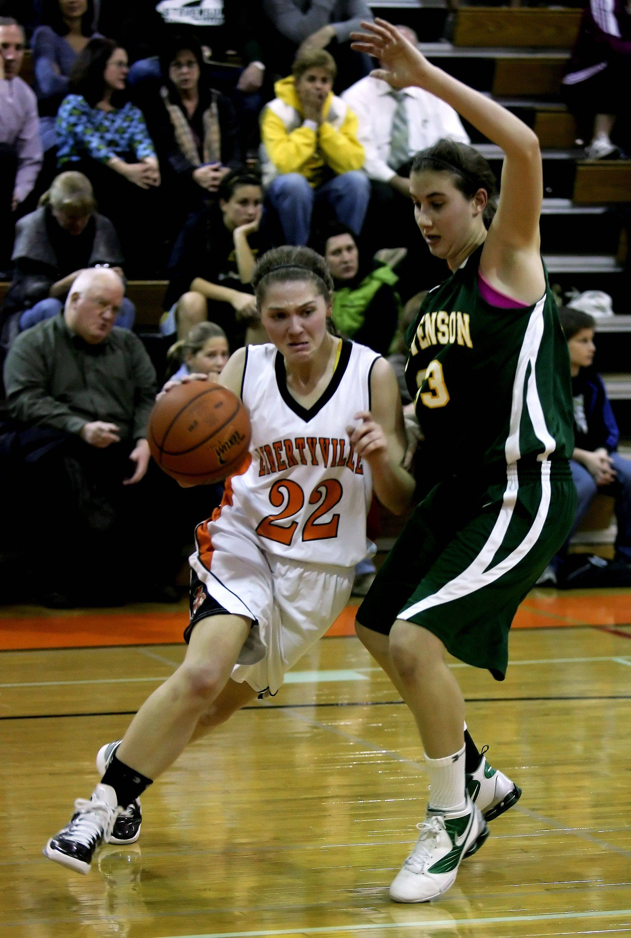 Libertyville player Olivia Wilcox drives by Stevenson player Michelle O'Brien.