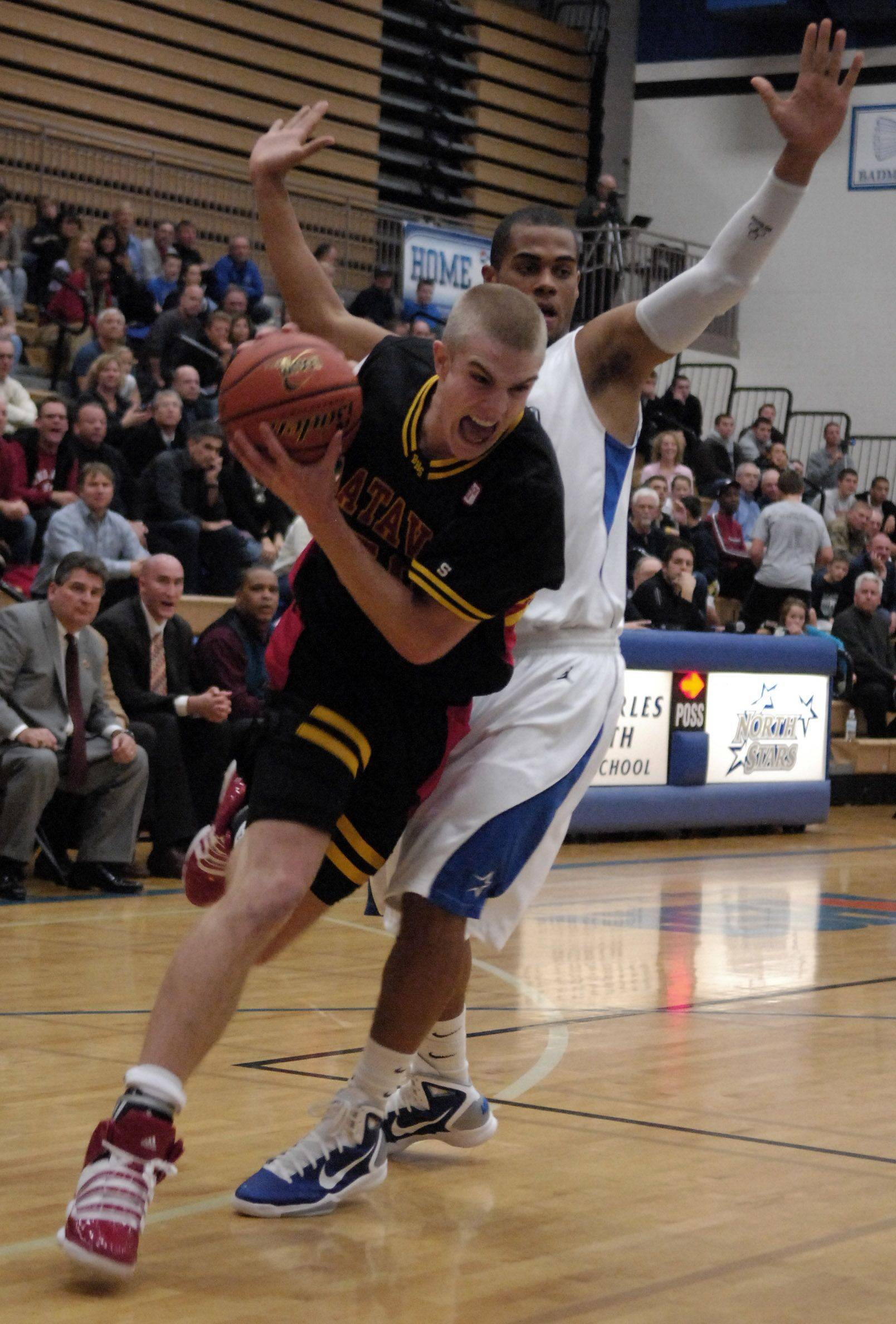 Batavia forward Elliott Vaughn drives past St. Charles North's Josh Mikes.