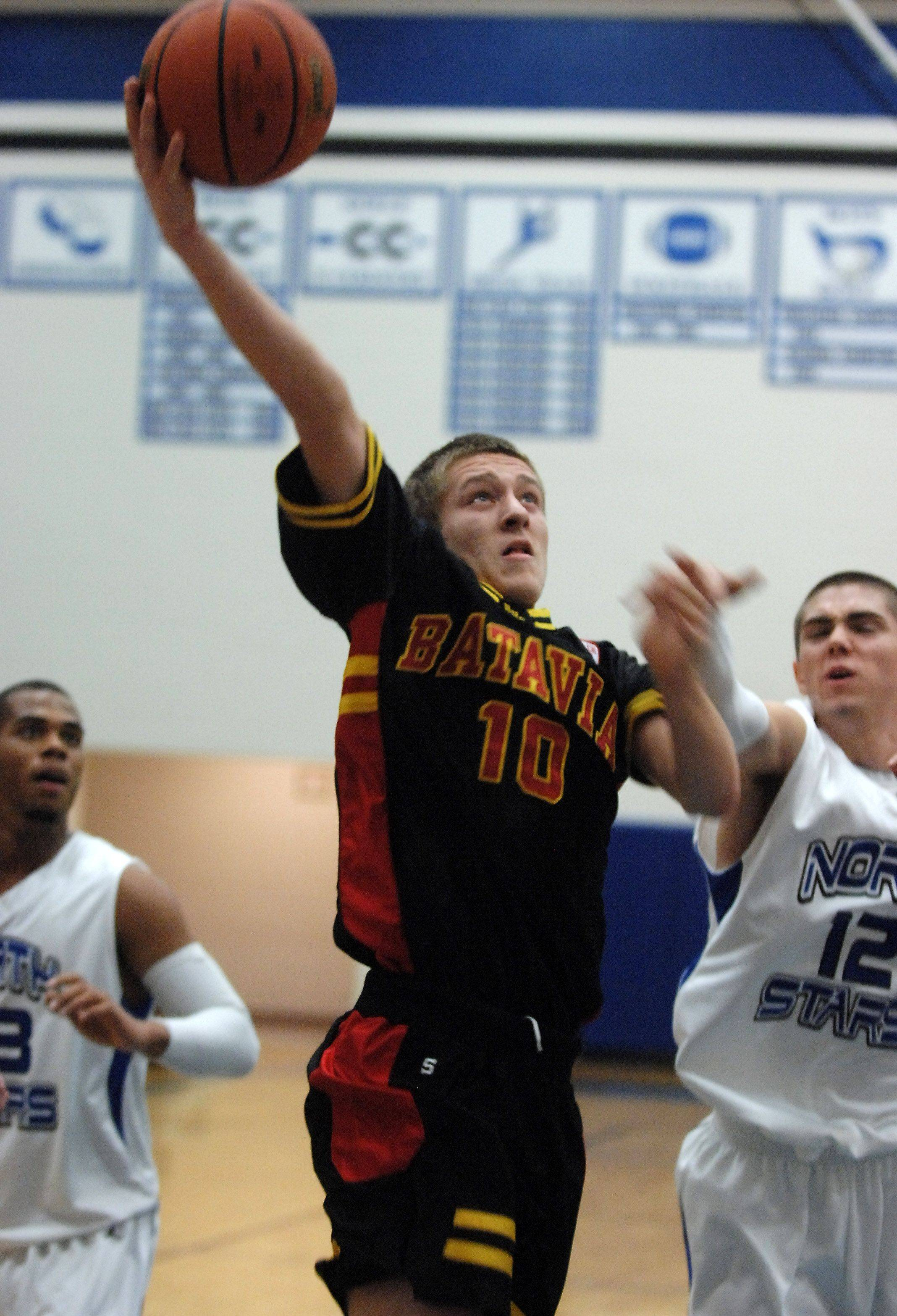 Batavia's Mike Rueffer drives and scores in front of St. Charles North's Quinten Payne.