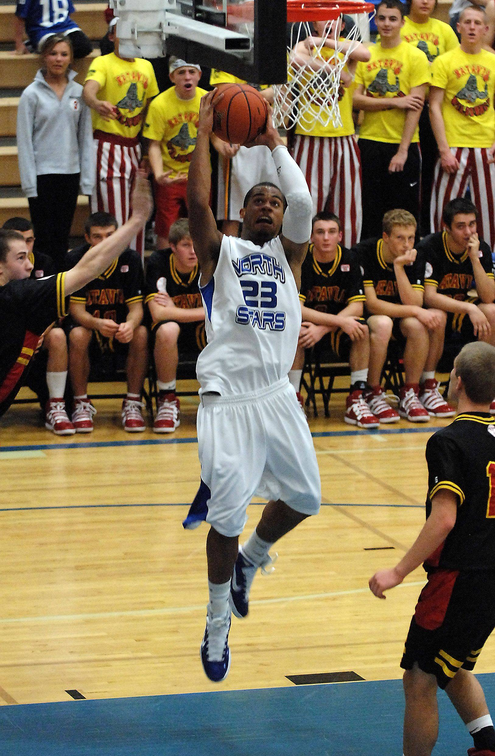 St. Charles North's Josh Mikes gets free under the basket against Batavia.