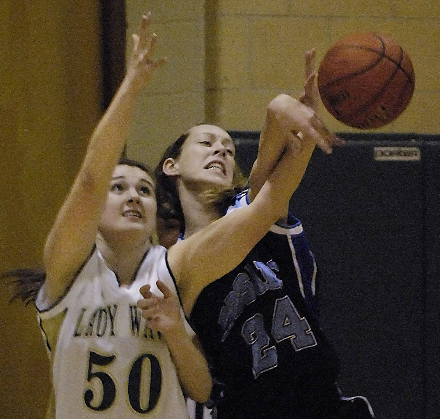 Rosary's Maddie Kombrink keeps the ball away from St. Edward's Alexandria Lee Thurday in Elgin.