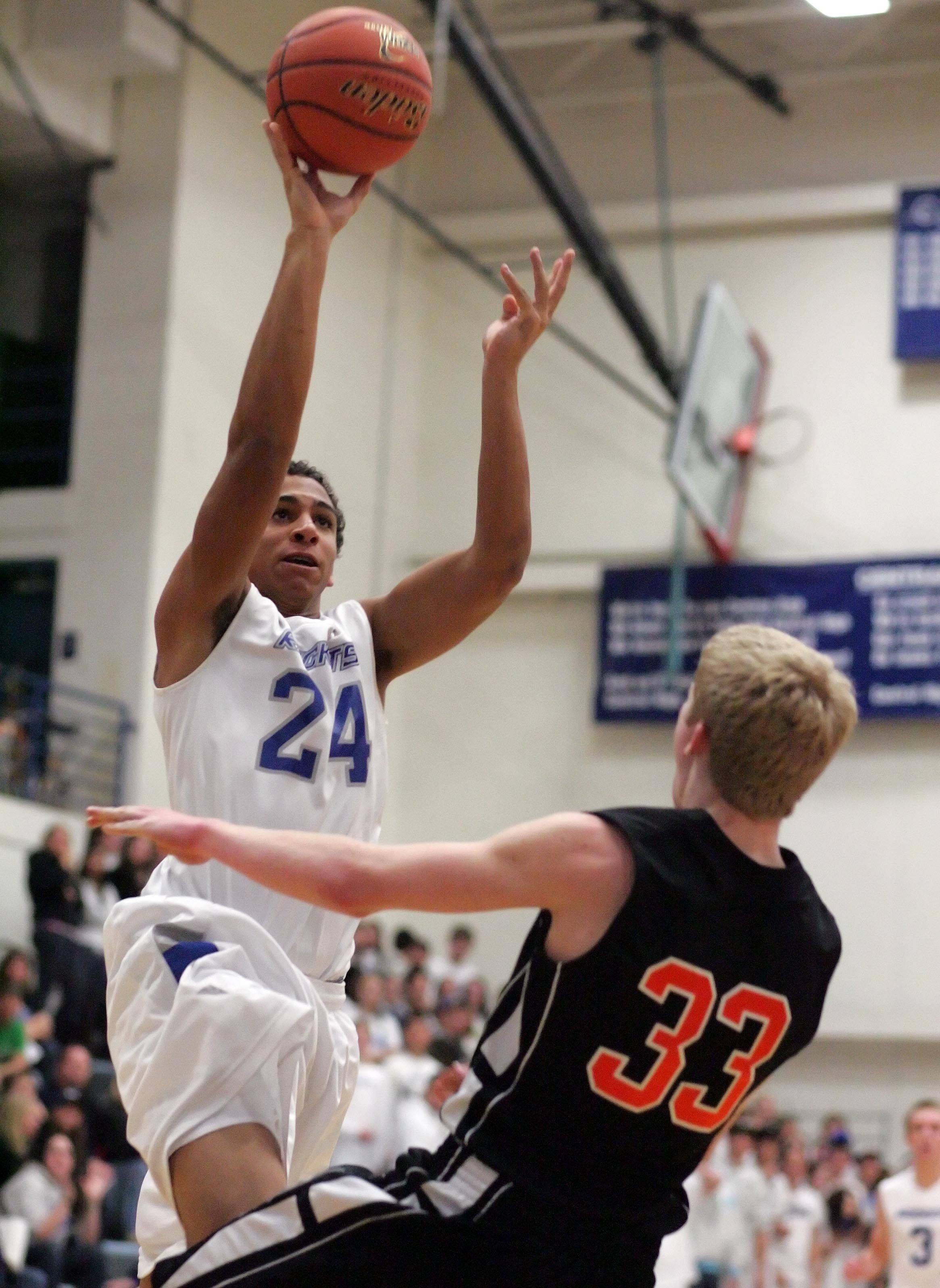 Burlington Central forward Michael Parker goes over Byron's Collin Russell.
