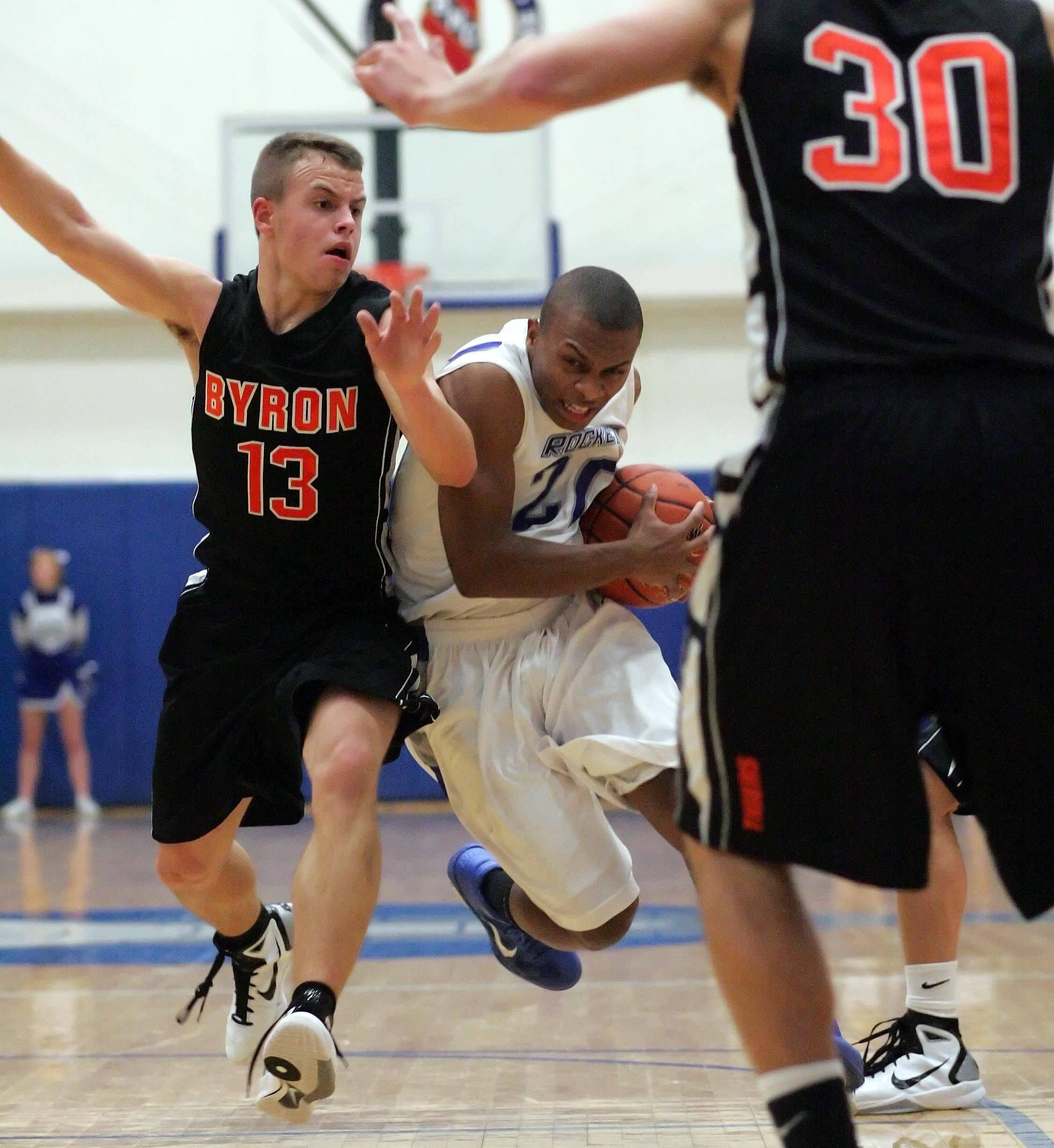 Burlington Central guard Ray Hunnicutt slips past Byron's Matt Groharing.