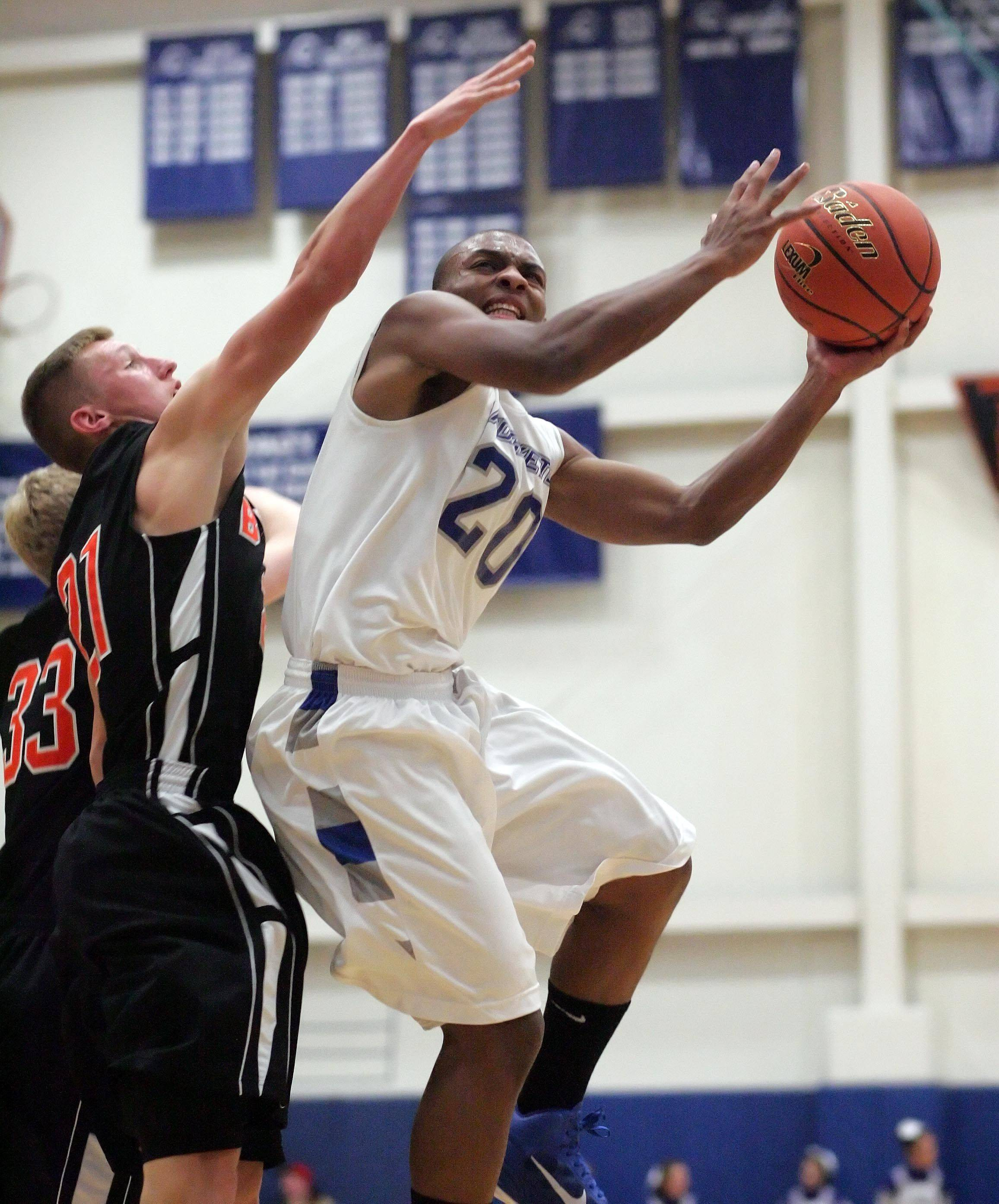 Burlington Central guard Ray Hunnicutt moves to the hoop.