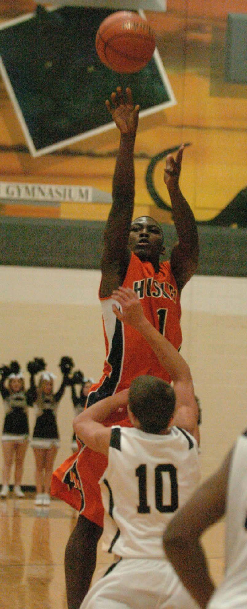 Jovonn Griffin of Naperville North puts up a shot at Glenbard North.