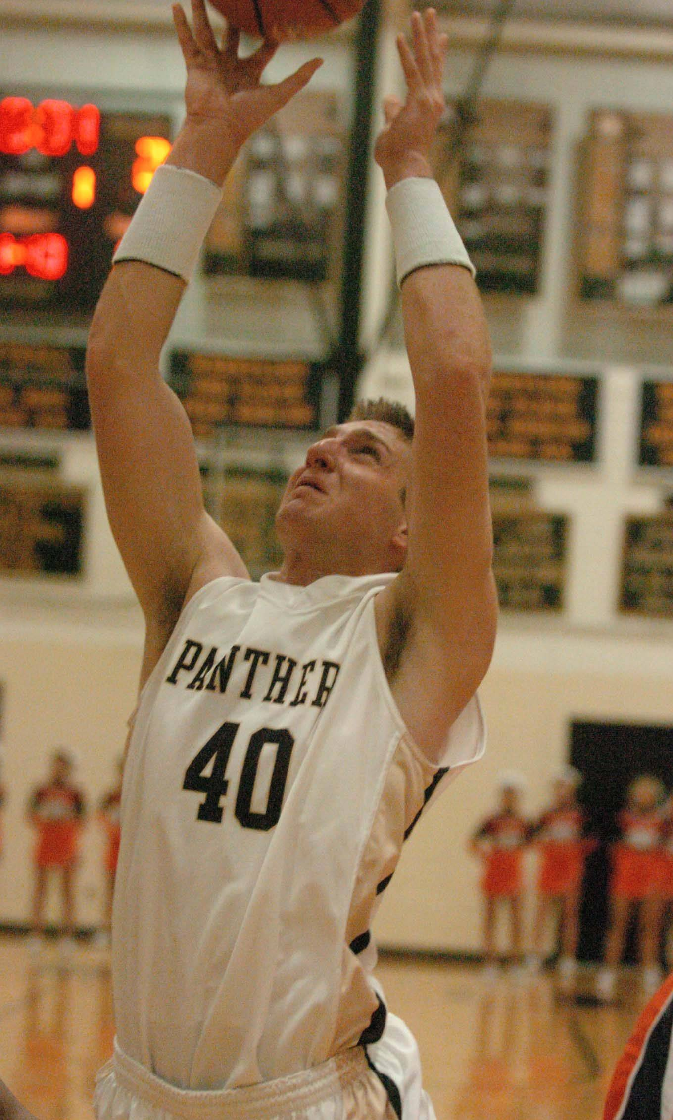 Matt Pemberton of Glenbard North goes up for a rebound against Naperville North.