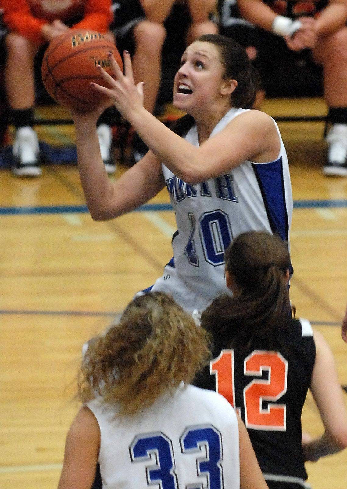 St. Charles North guard Tess Fischer drives.