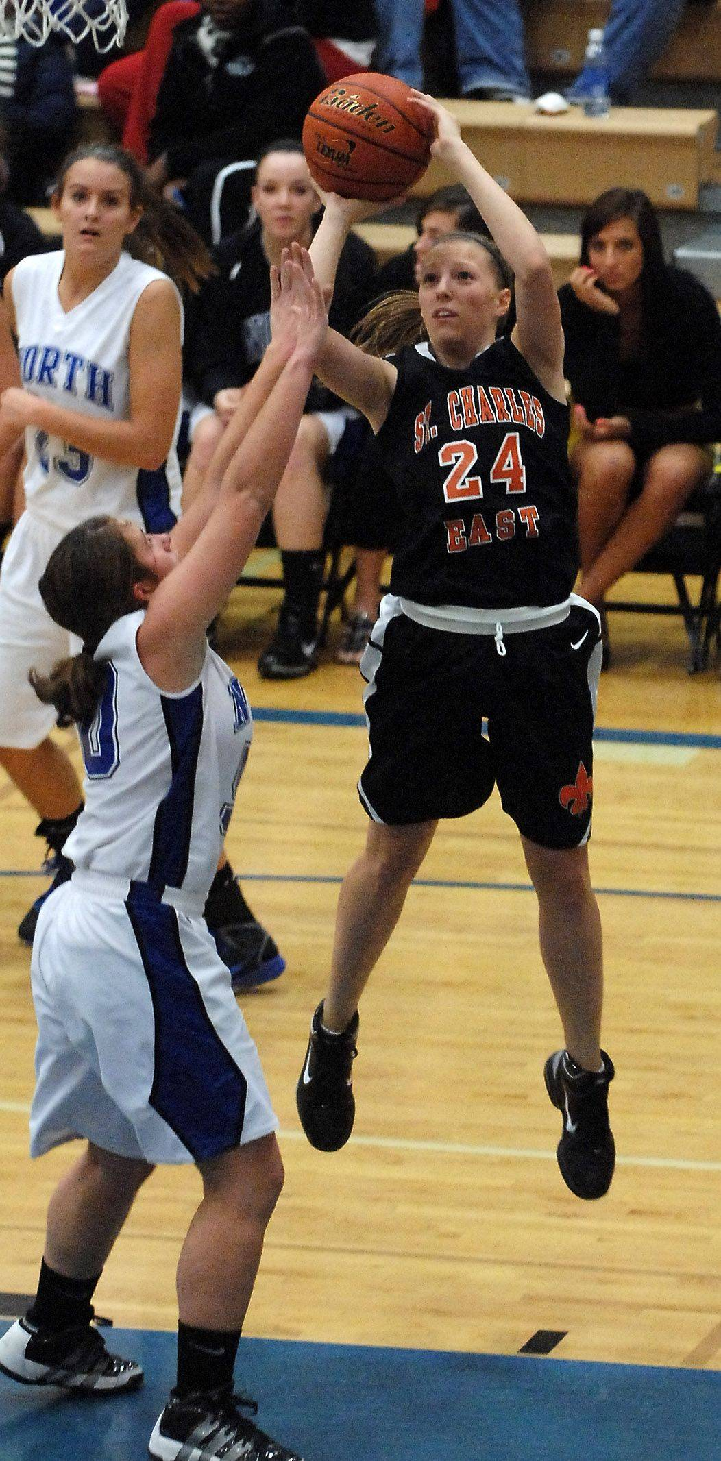 St. Charles East forward Laney Deckrow puts up a short jumper .