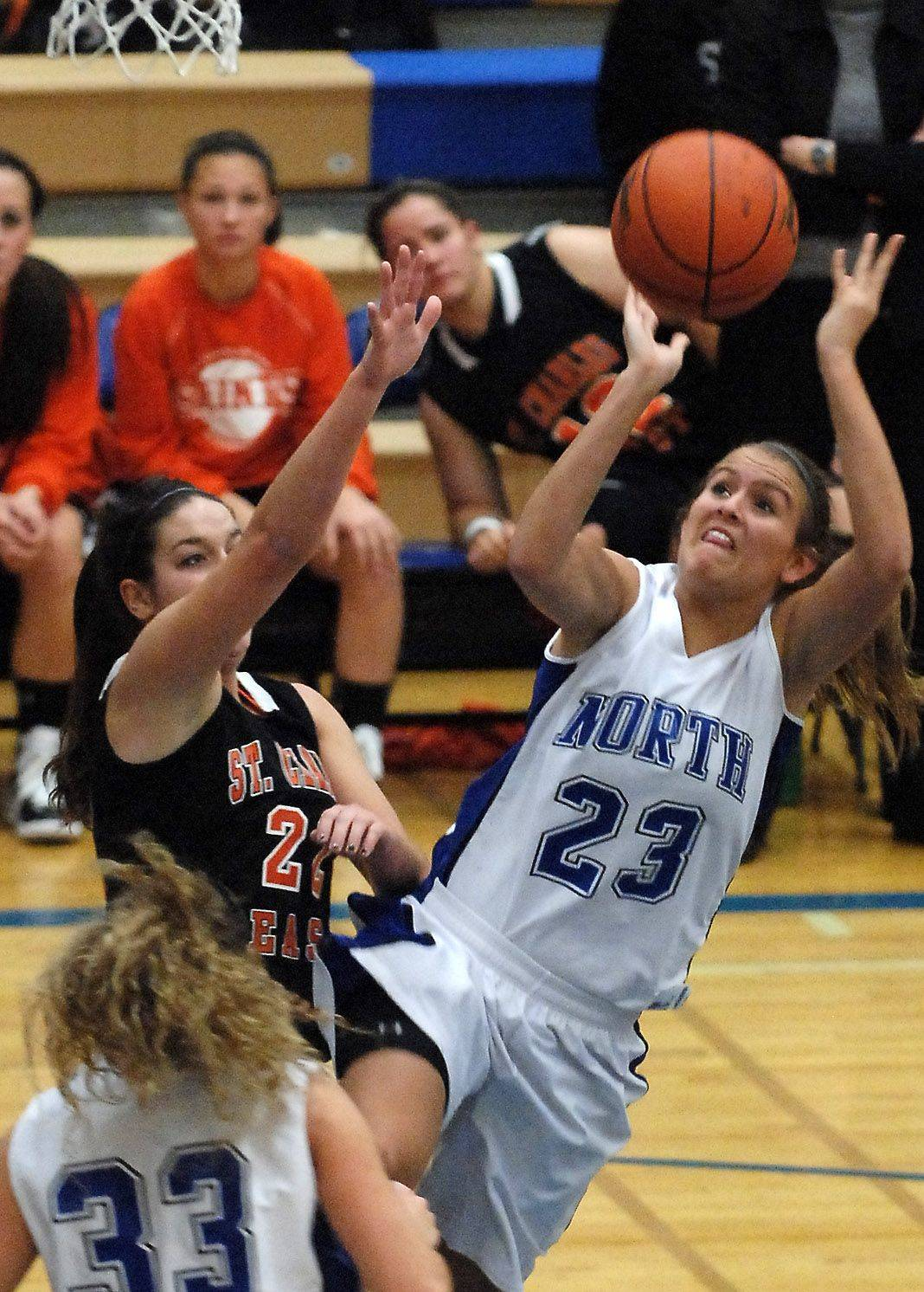 St. Charles North forward Leah Horton puts up a shot over St. Charles East guard Dani Asquini.