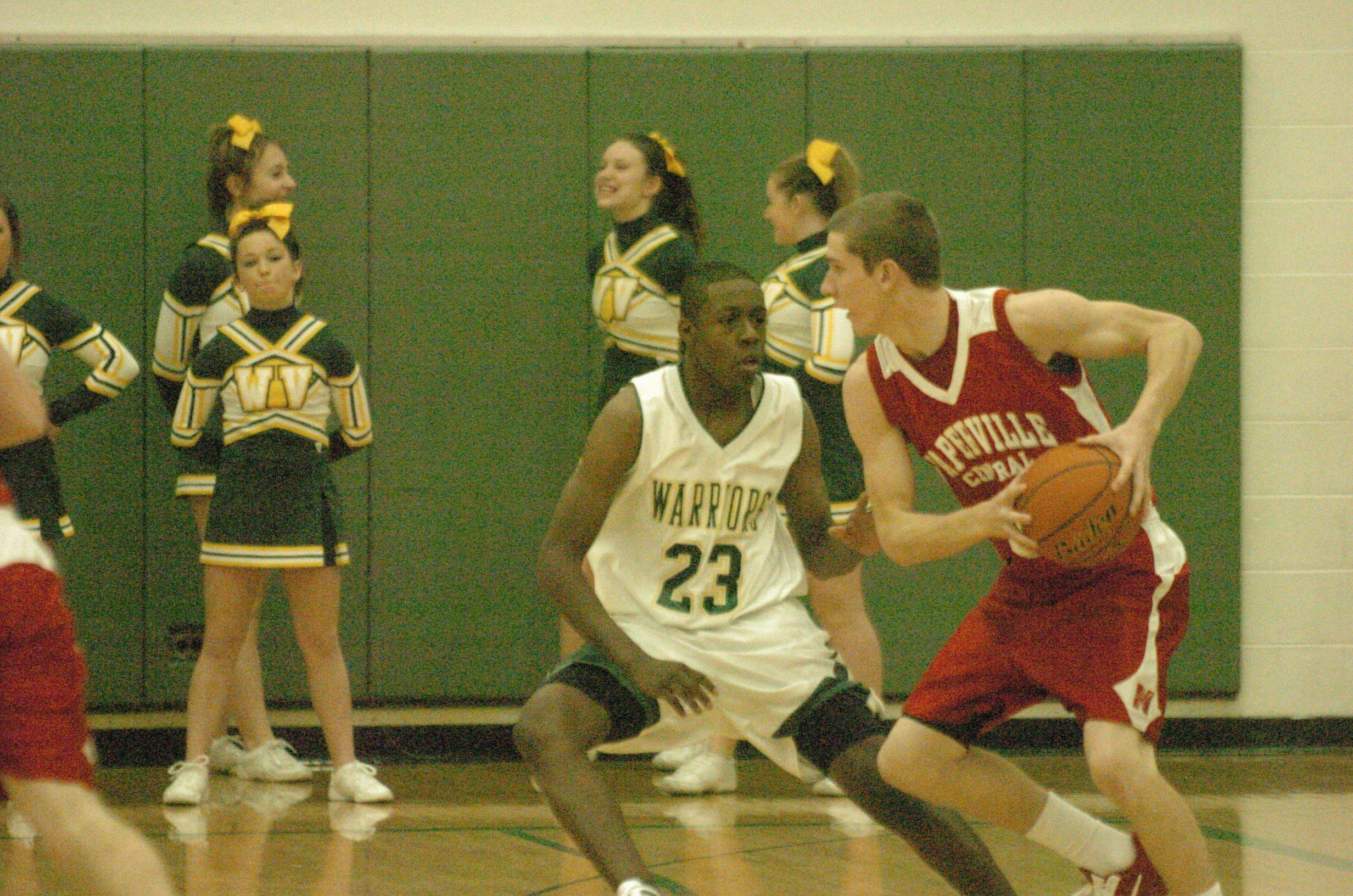 Boys basketball. Naperville Central at Waubonsie Valley in Aurora.