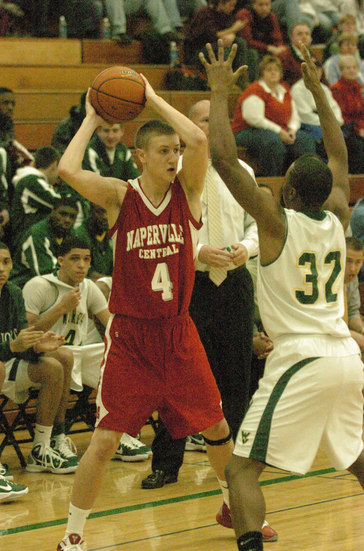 Alex Renn of Naperville Central looks to pass over Jakobi Johnson of Waubonsie Valley during game action Saturday.