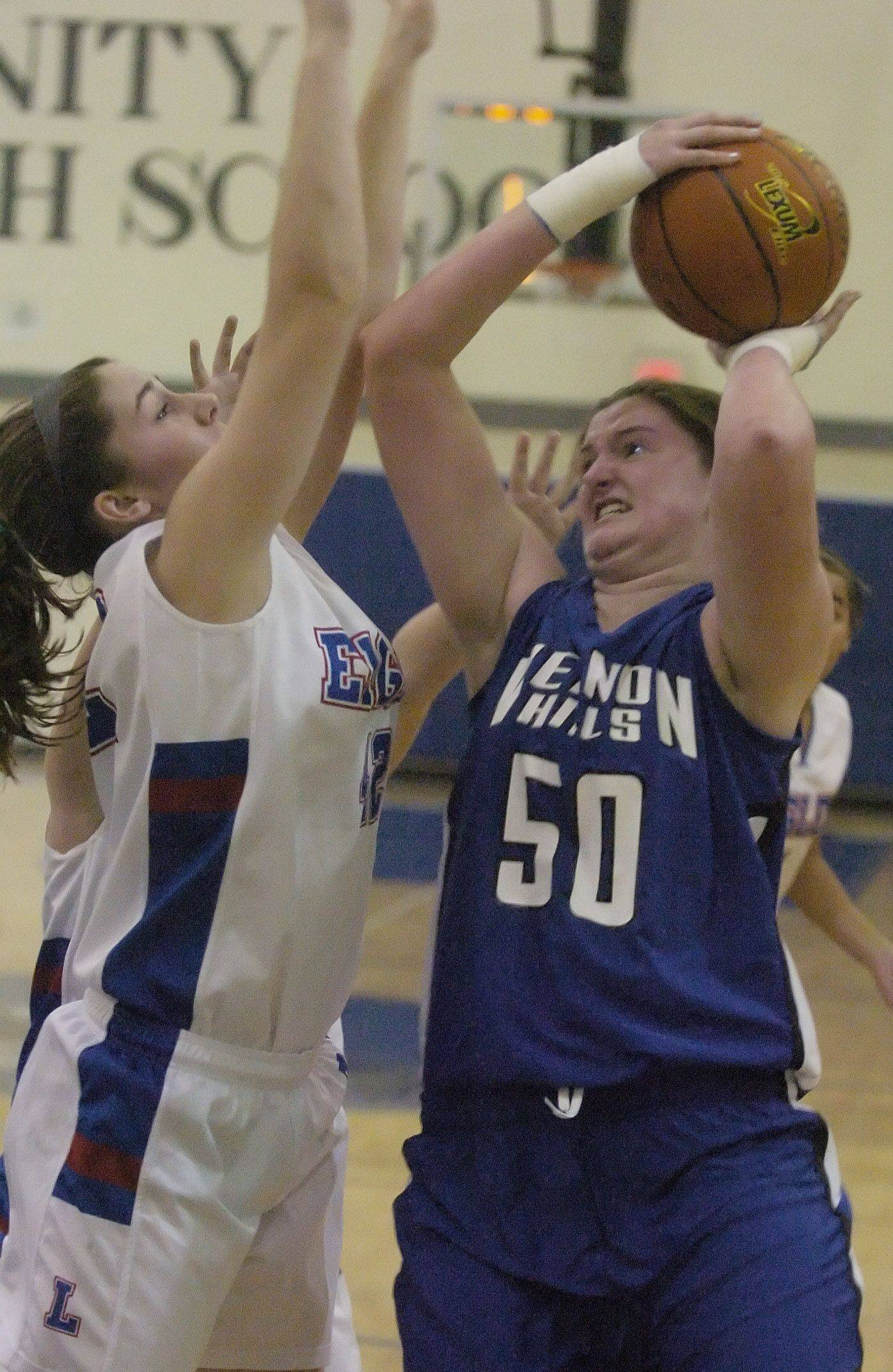 Vernon Hills' Meri Bennett-Swanson, left, goes strong to the basket against Lakes' Terese McMahon Saturday in Lake Villa.