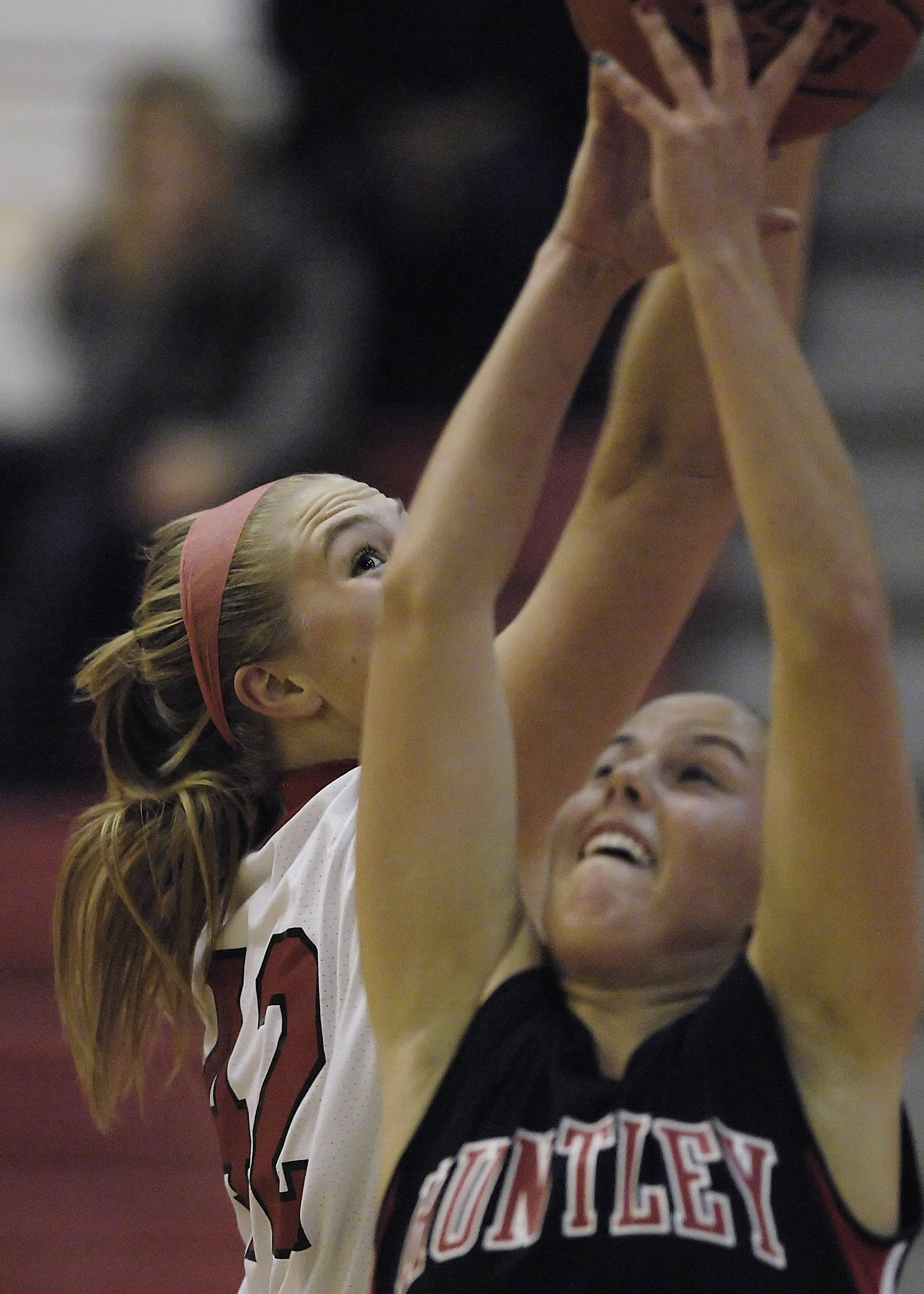 Barrington's Shelby Whigham keeps her eye on the ball as she stretches for a rebound against Huntley's Rachel Chapuis.