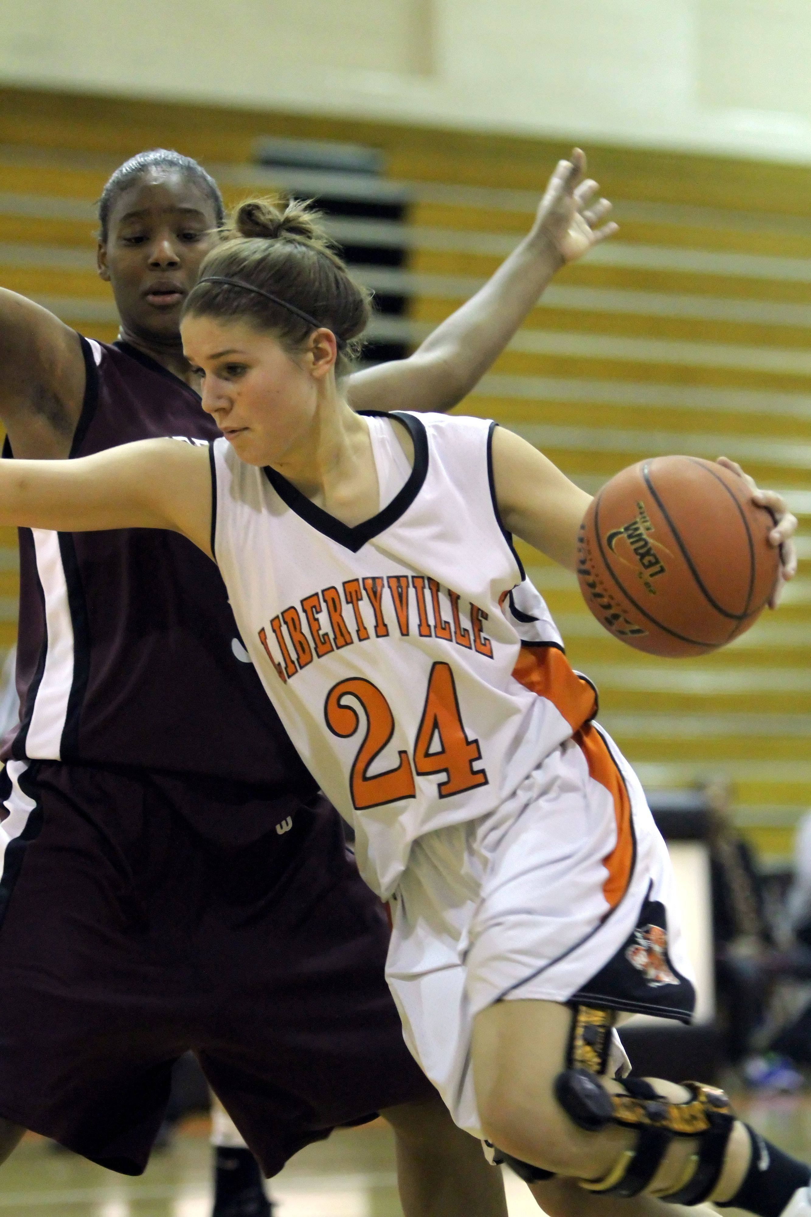 Libertyville's Kaca Savatic, right, drives on Zion's Octavia Crump.