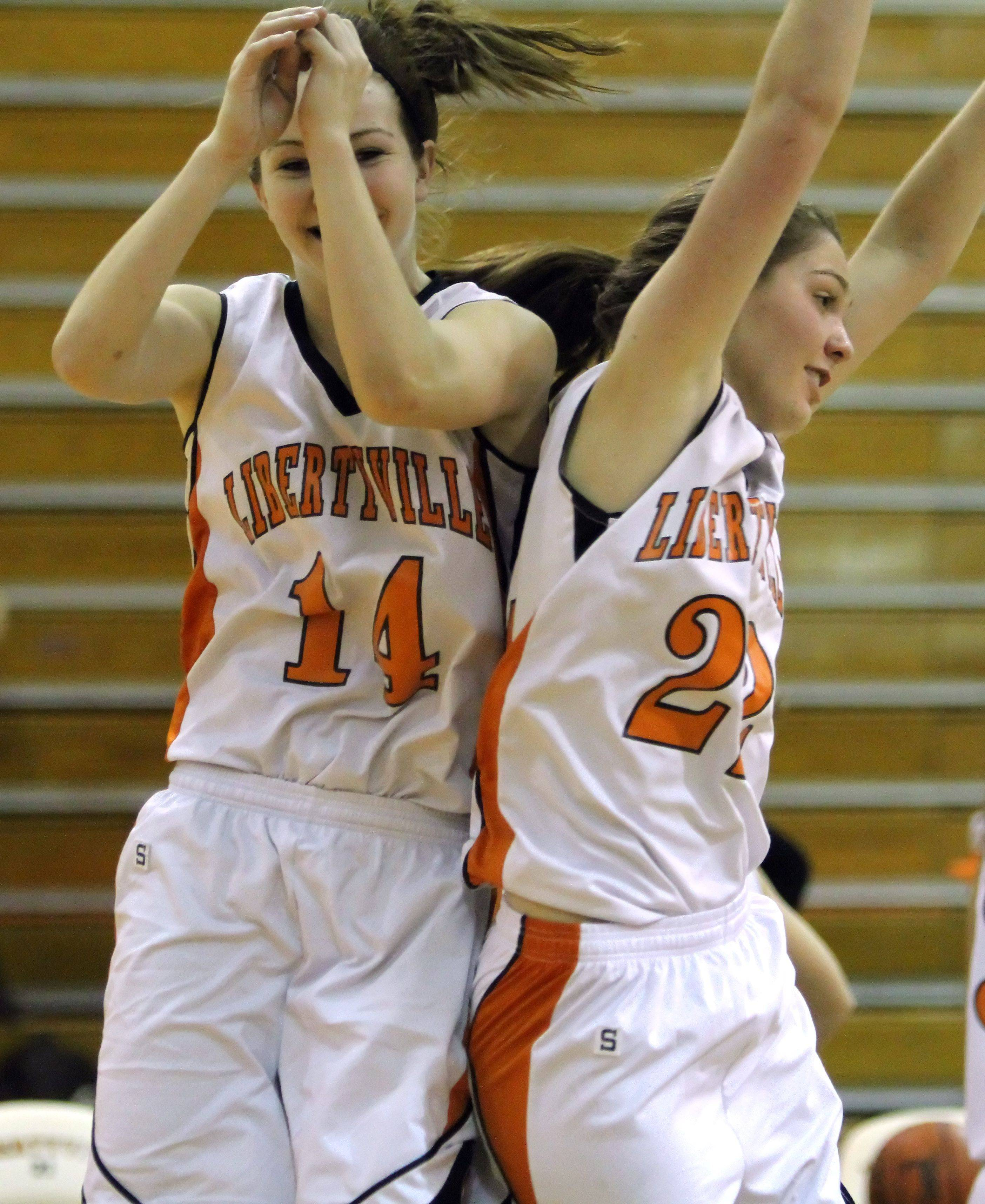 Libertyville's Savanna Trees, left, and Olivia Wilcox celebrate after beating Zion-Benton .