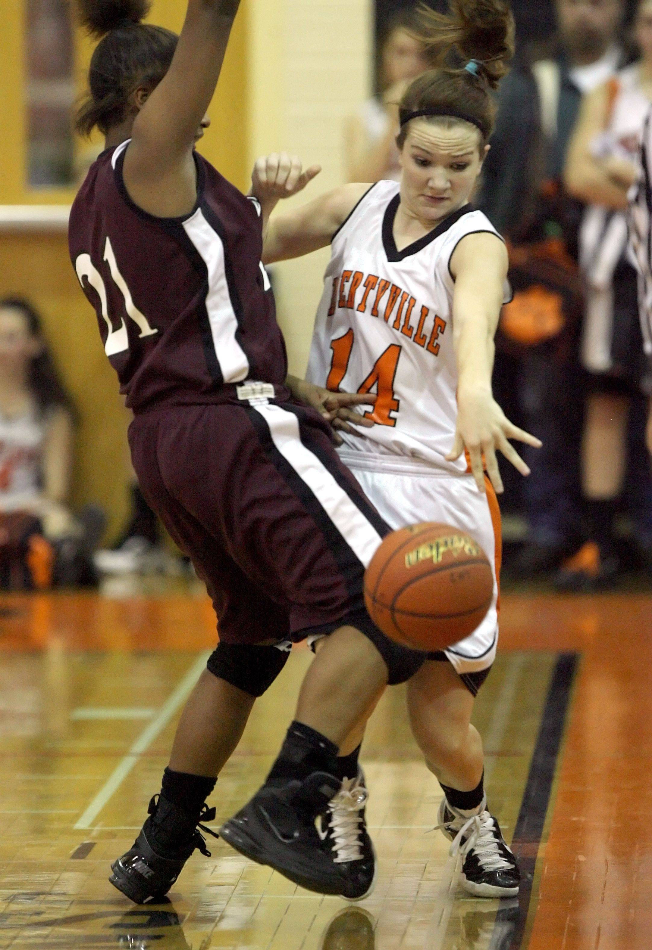 Libertyville's Savanna Tress, right, tries to dribble past and Zion's Samantha Rodriguez .