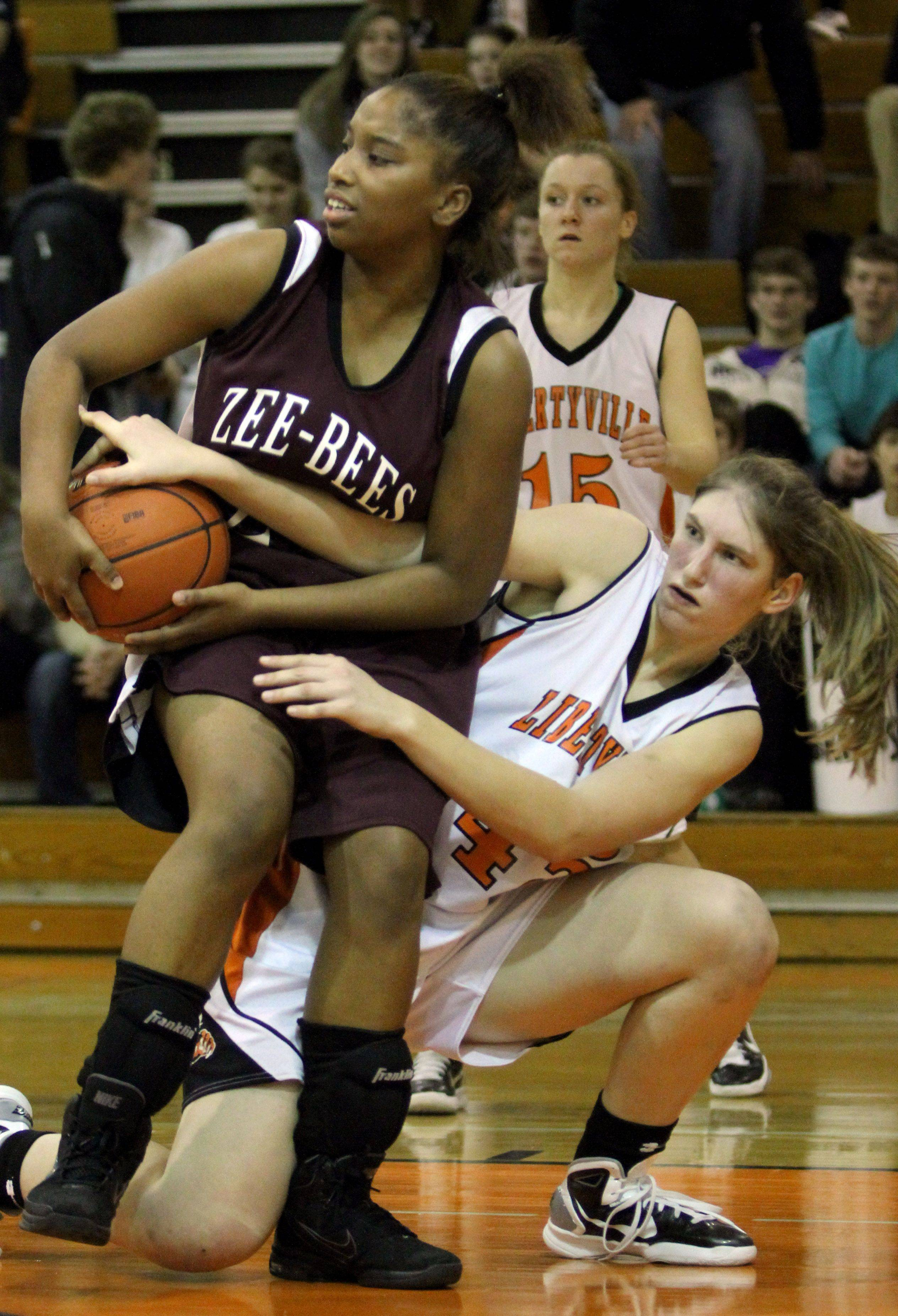 Libertyville's Nicole Kruckman, right, and Zion's Samantha Rodriguez battle for a loose ball.