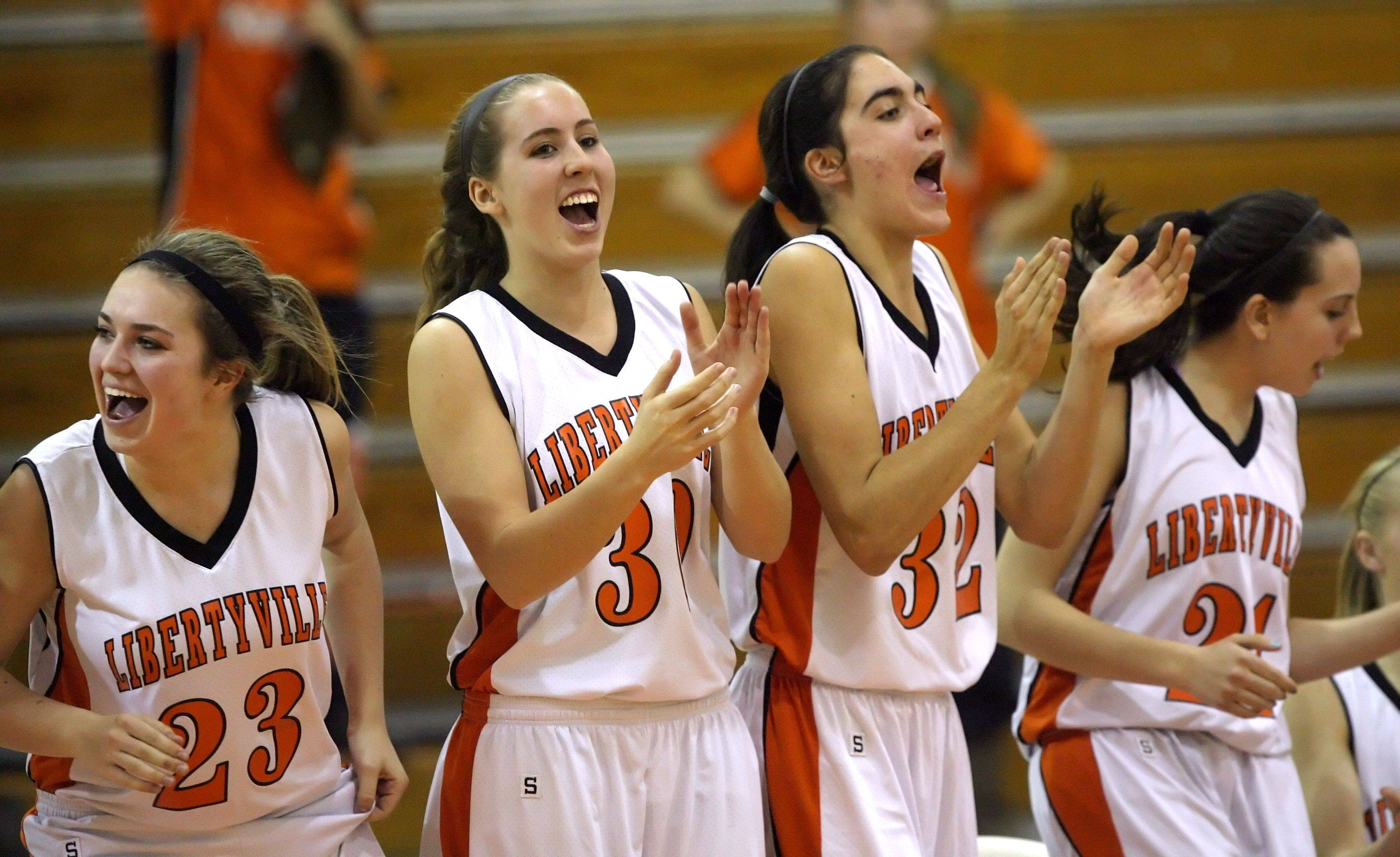 Players on the Libertyville bench cheer during their win over Zion-Benton.