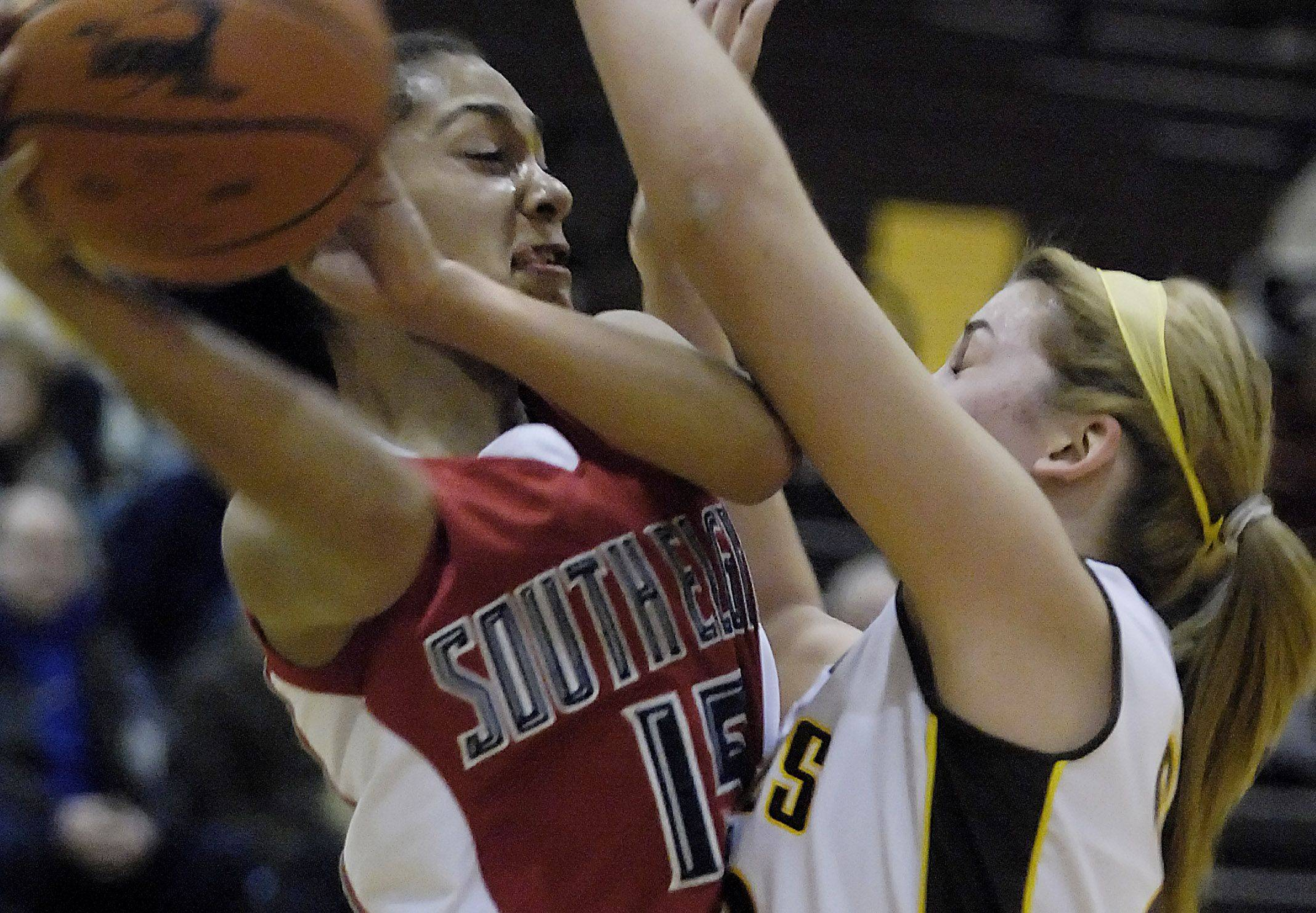 South Elgin's Becca Smith tries to pass around Jacobs' Melanie Schwerdtmann .