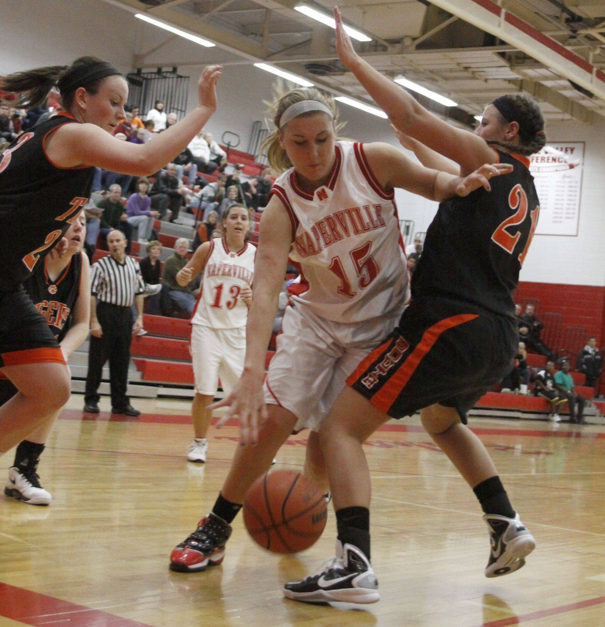 Naperville Central's Victoria Trowbridge tries to get through Wheaton Warrenville South's defens.