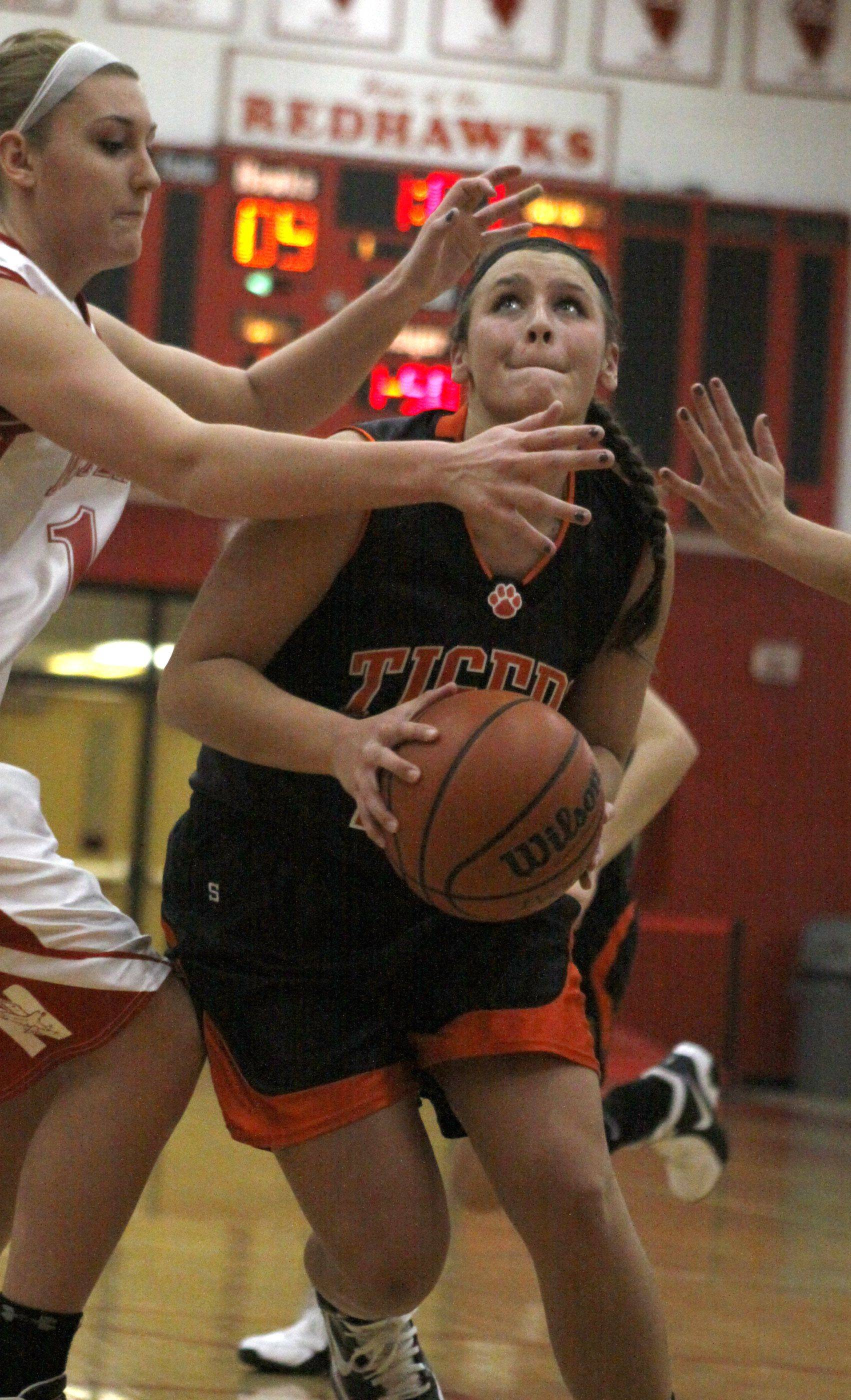 Naperville Central's Victoria Trowbridge attempts to stop Wheaton Warrenville South's Krysta Watts from making it to the basket.