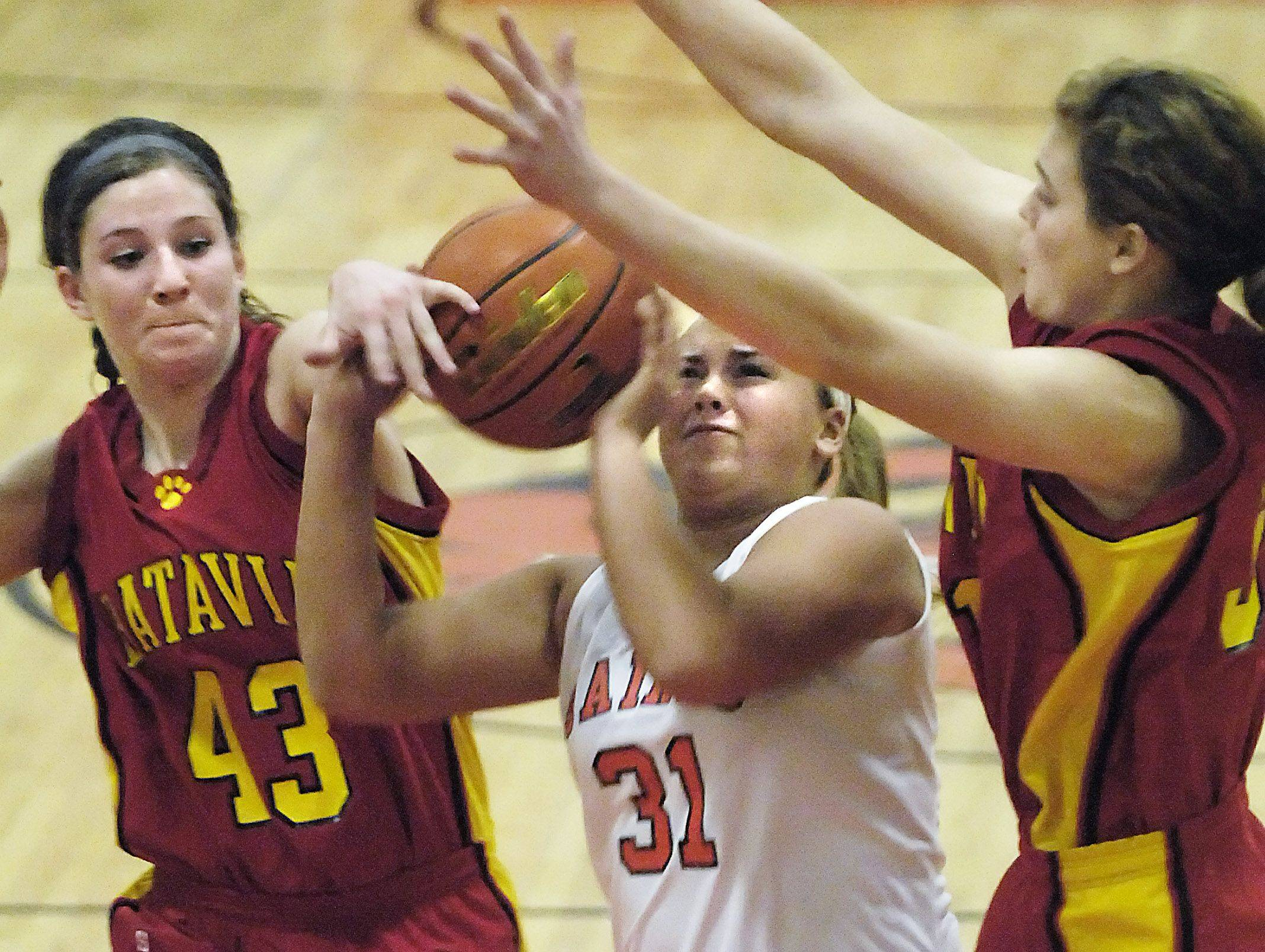 Batavia's Maddie Sychta, left, and Katie Ryan cover St. Charles East's Morgan Vyzral .