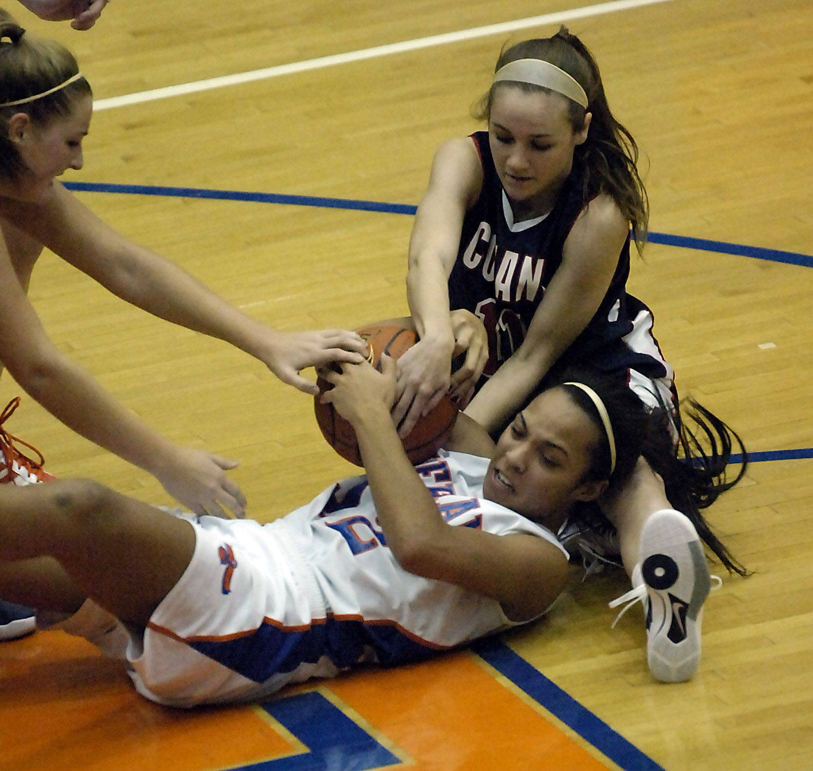Conant's Hailey Andress and Hoffman Estates' Jada Stotts battle for the ball.