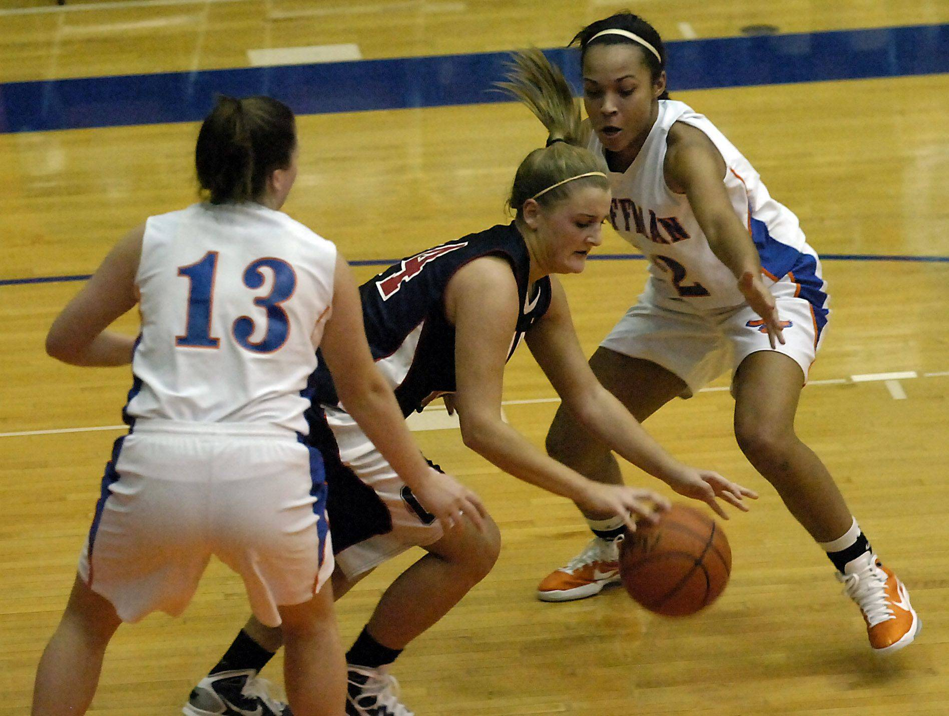 Conant's Jenna Heneghan splits the Hoffman Estates defense of Jada Stotts and Melanie McGinn in the first half.