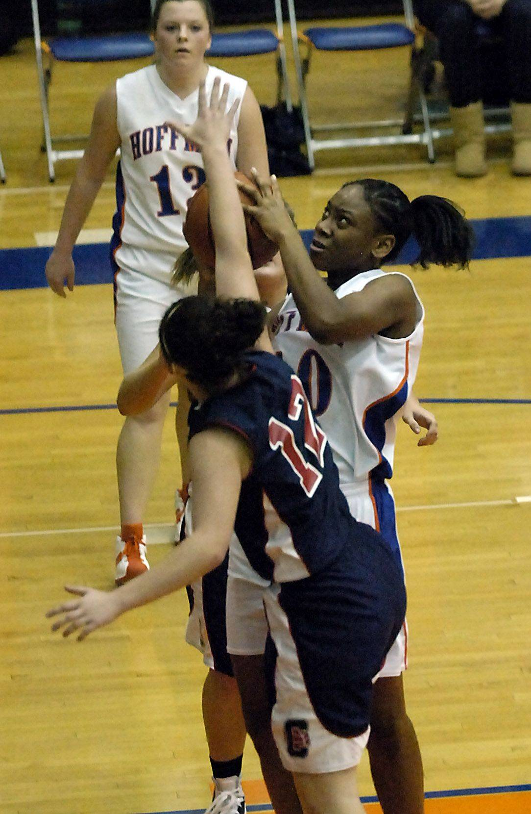 Hoffman Estates' Destinee Young scores as Conant's Lindsay Fillingim tries to block in the first half .