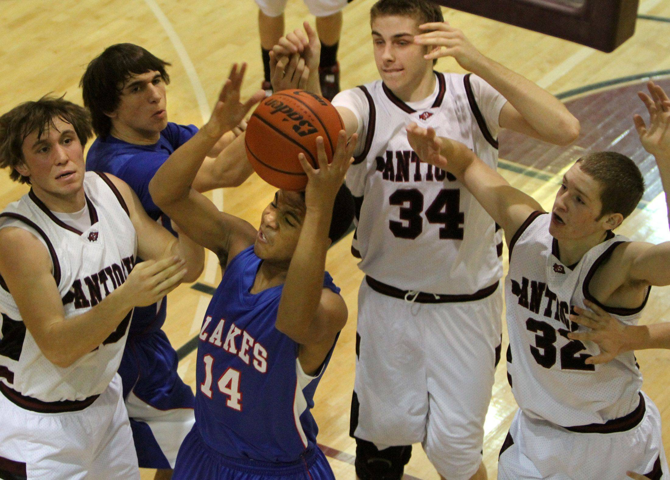 Lakes' Blain Tanner pulls in a defensive rebound at Anticoh.