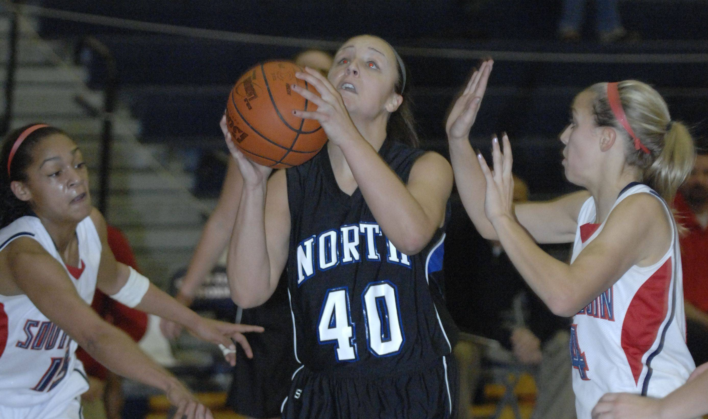 Laura Stoecker/lstoecker@dailyherald.com Images from the St. Charles North vs. South Elgin girls basketball game Saturday, December 11, 2010.