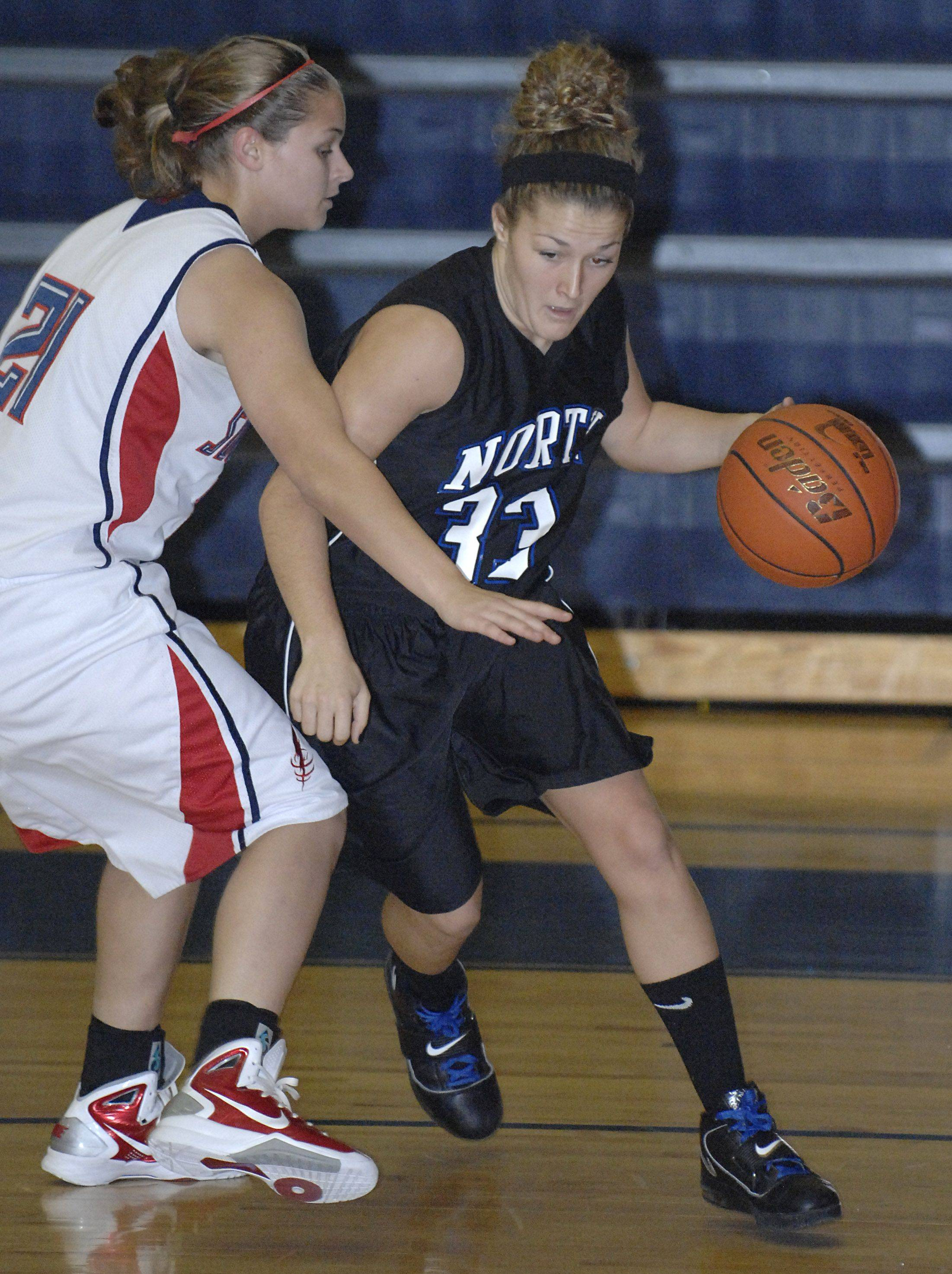 Laura Stoecker/lstoecker@dailyherald.com South Elgin's Amanda Behles attempts to block St. Charles North's Taylor Russell in the first quarter on Saturday, December 11.