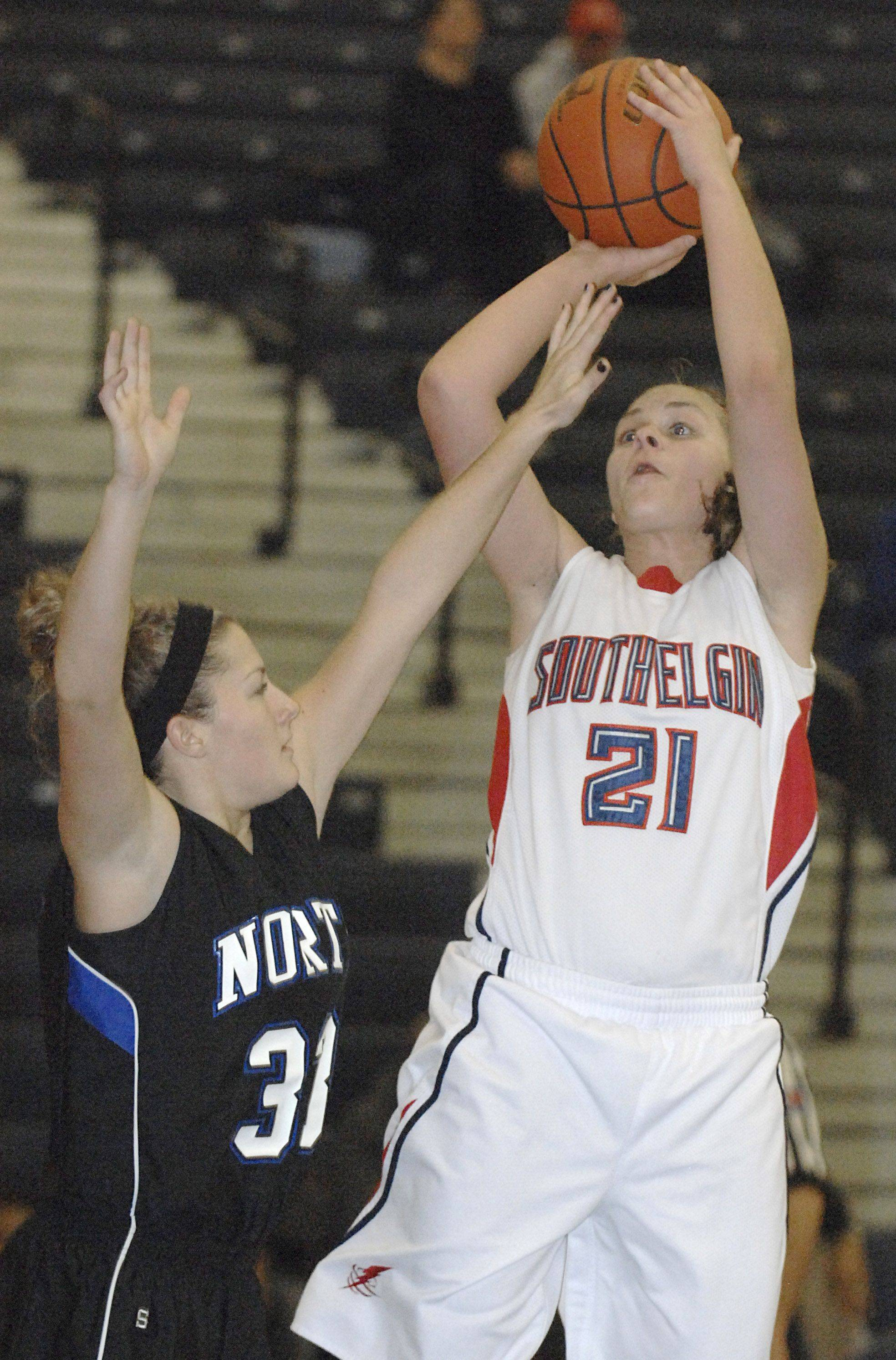 Laura Stoecker/lstoecker@dailyherald.com South Elgin's Amanda Behles takes a shot over St. Charles North's on Taylor Russell in the second quarter on Saturday, December 11.