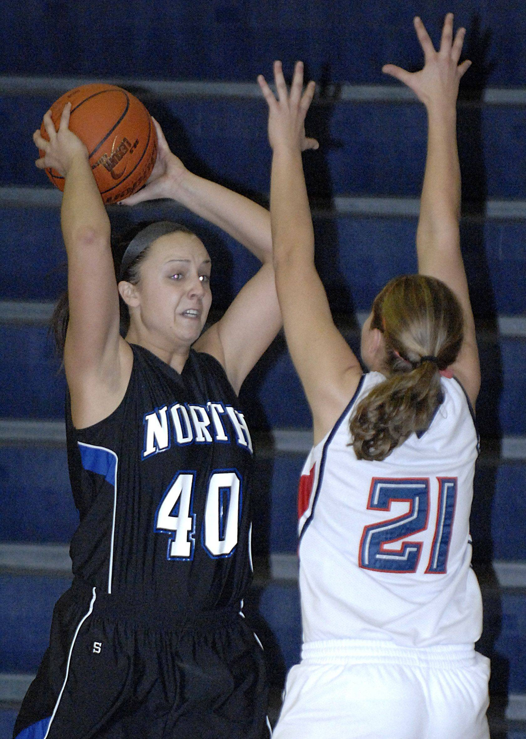 Laura Stoecker/lstoecker@dailyherald.com South Elgin's Amanda Behles attempts to block a pass by St. Charles North's Tess Fischer in the first quarter on Saturday, December 11.