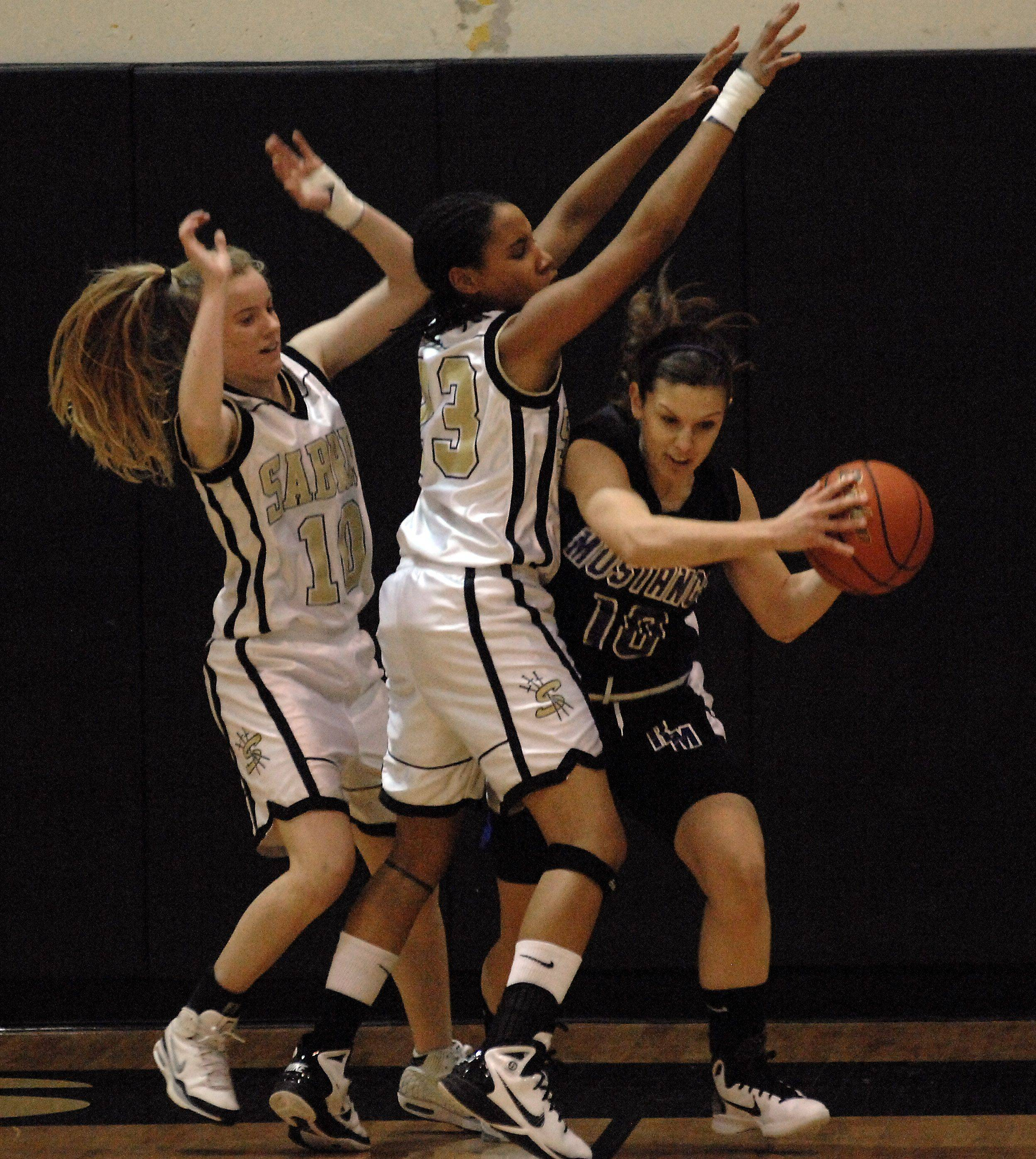 Streamwood's Amanda Patterson and Deja Moore guard Rolling Meadows' Madelynn Conlin.