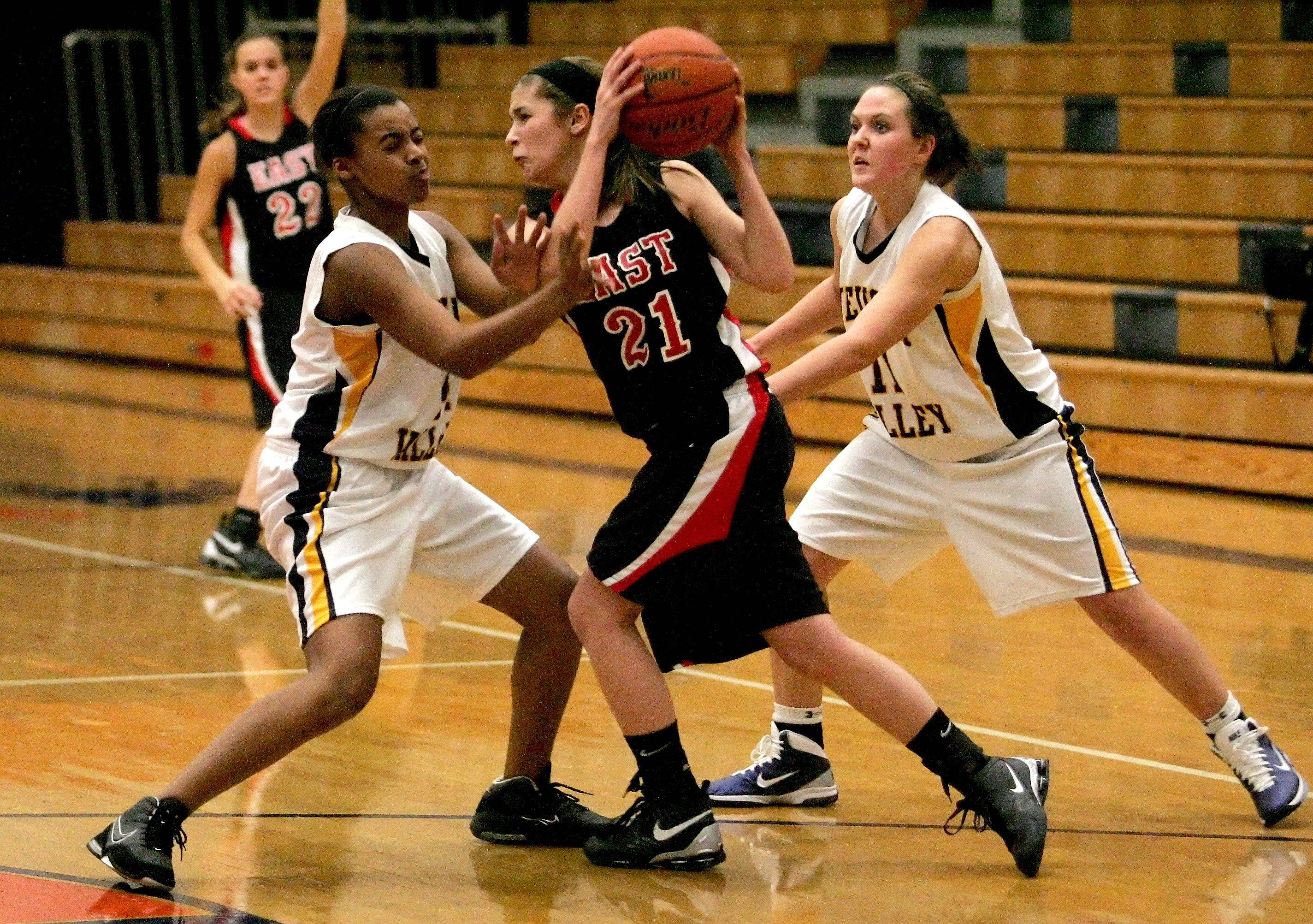 Kelly Eberle of Glenbard East, center, gets caught between Amber Smith, left and Megan Doody, right, of Neuqua Valley.