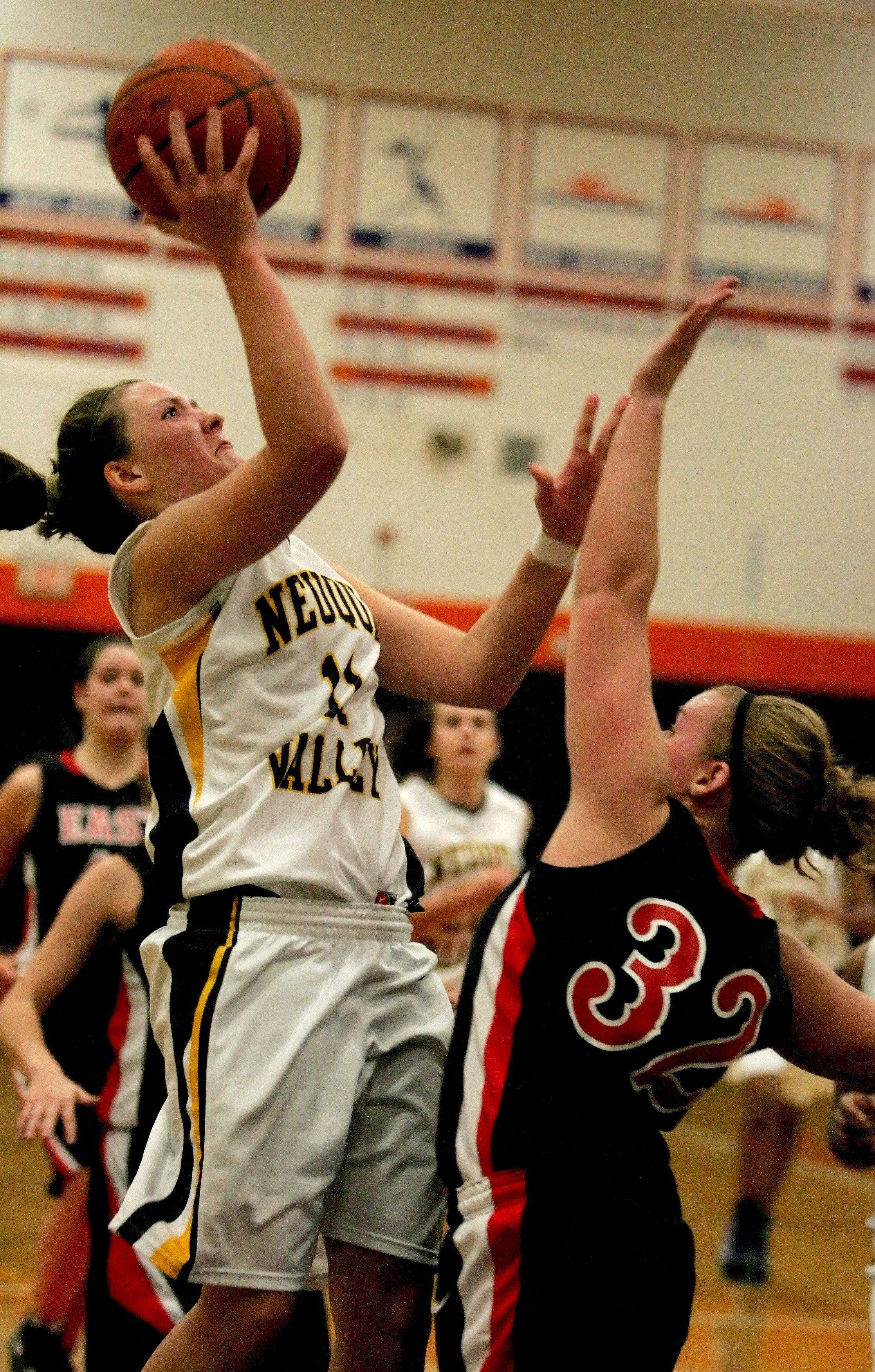Megan Doody of Neuqua Valley, left, makes a shot over Megan Shannon of Glenbard East .