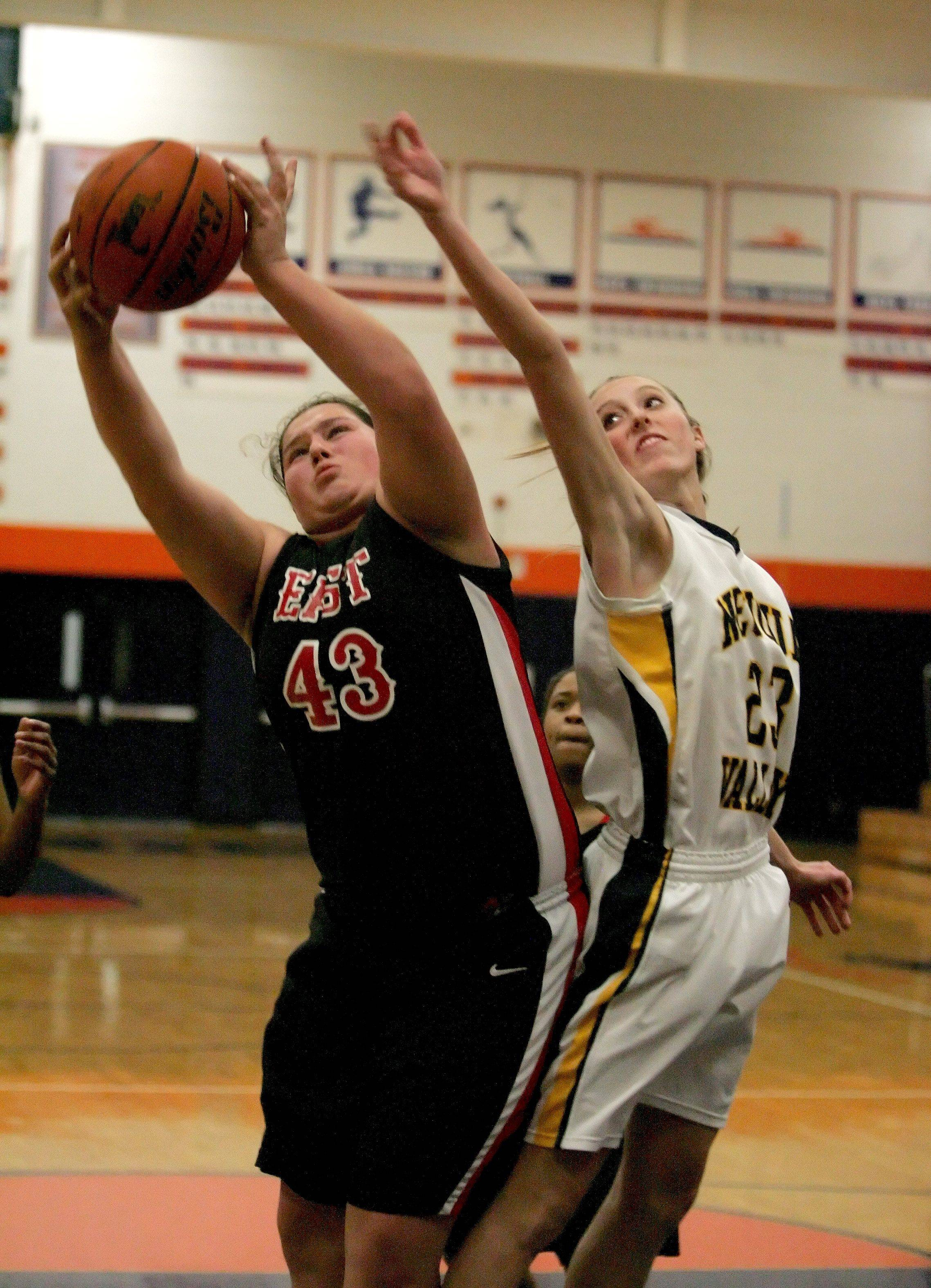 Michaela Stranski of Glenbard East, left, grabs a rebound over Allison Hedrick of Neuqua Valley.