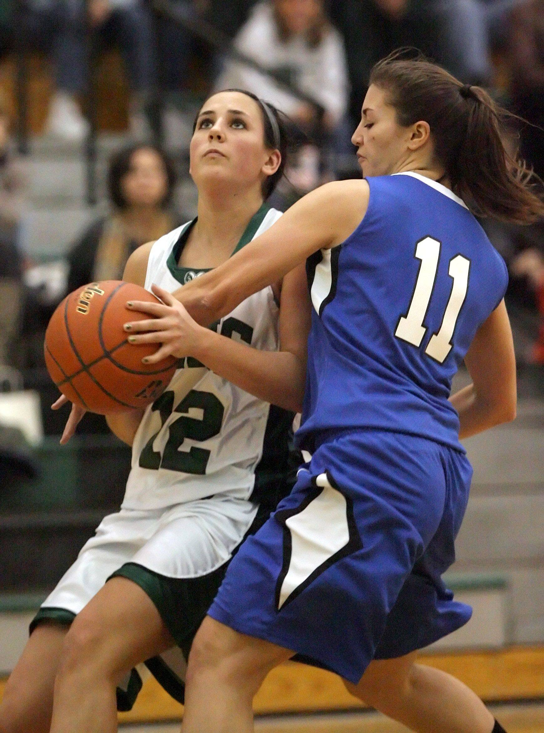 Grayslake Central's Claire Brennan, left, drives on Woodstock's Odessa Peters on Tuesday night at Grayslake Central.